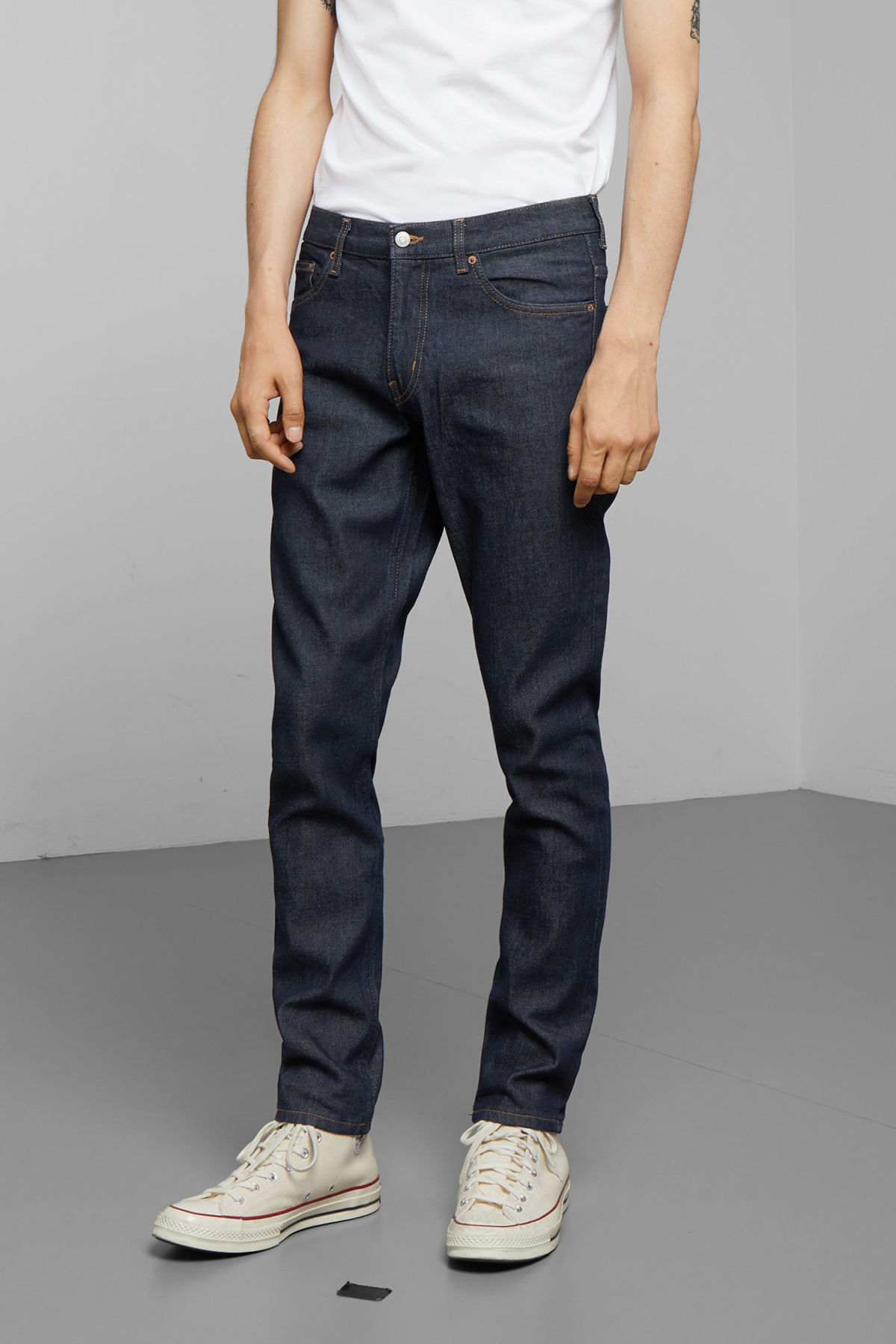 Model side image of Weekday friday soaked jeans in blue