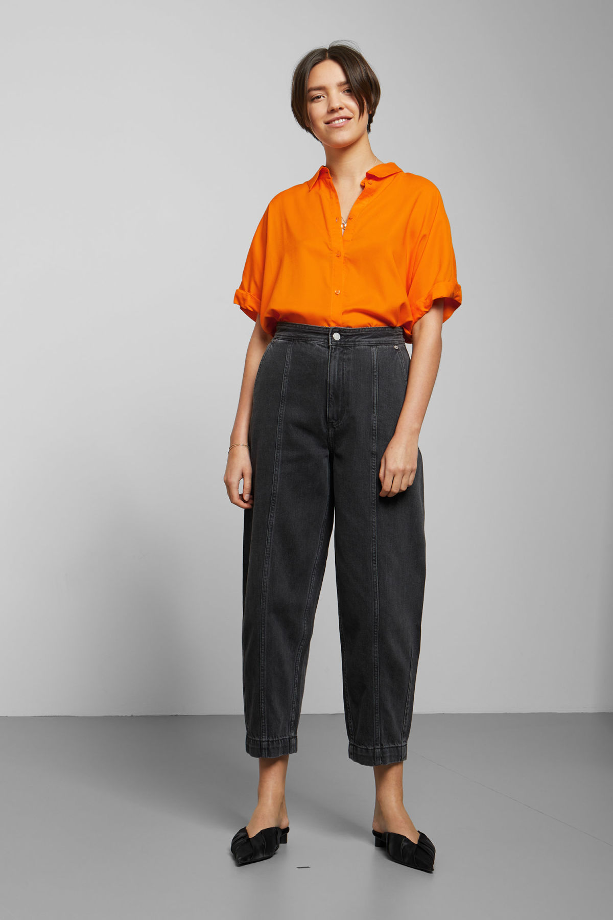 Model side image of Weekday groove blouse in orange