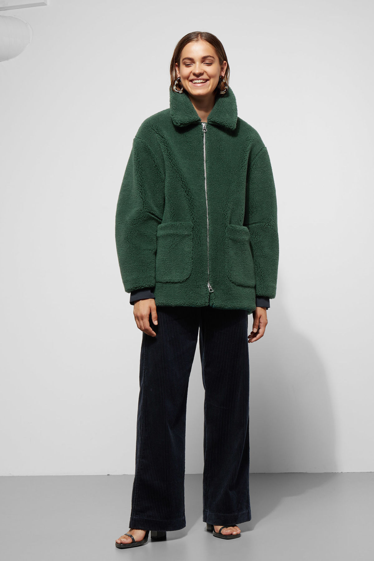 Model side image of Weekday felice jacket in green