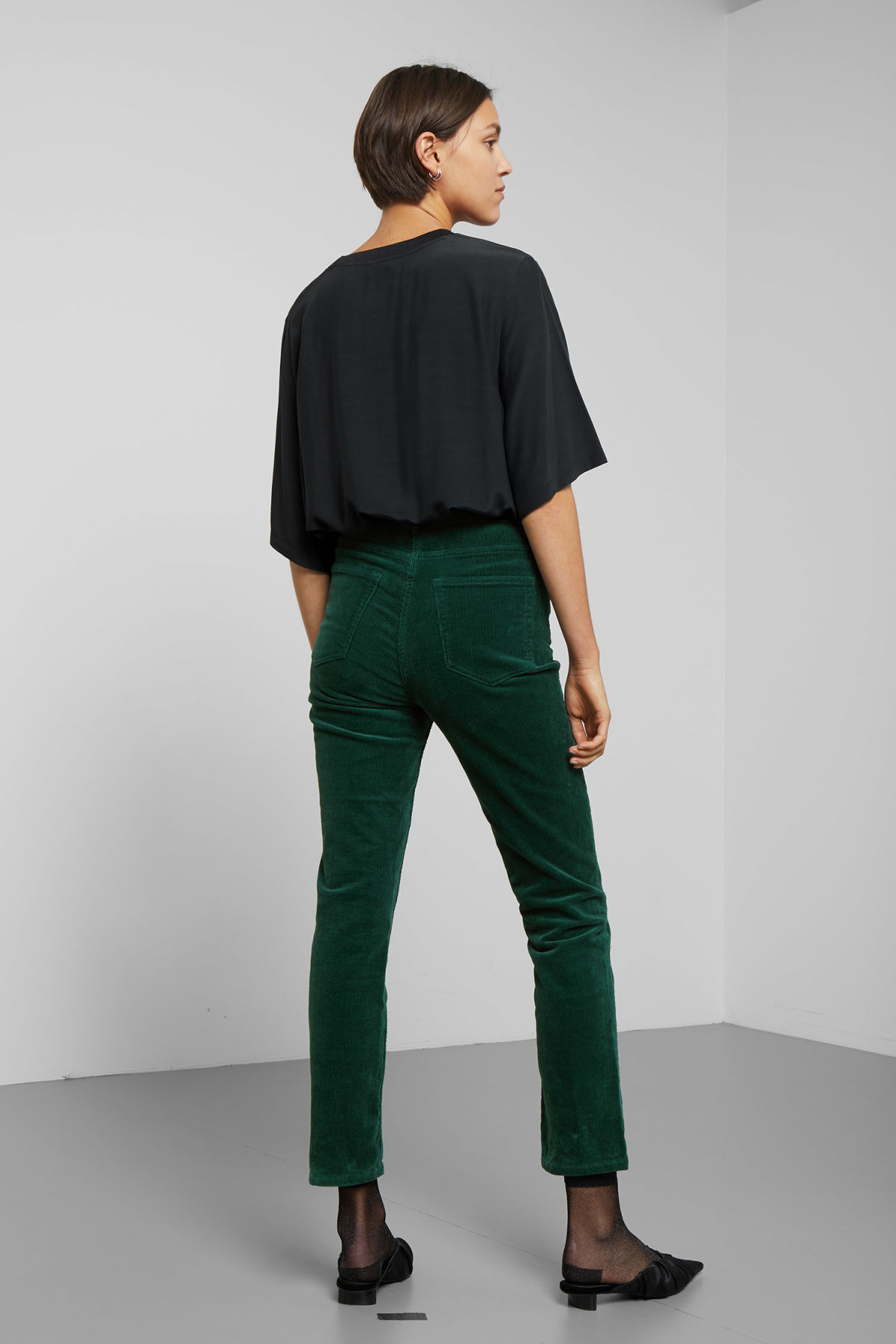 Model back image of Weekday eve cord trousers in green