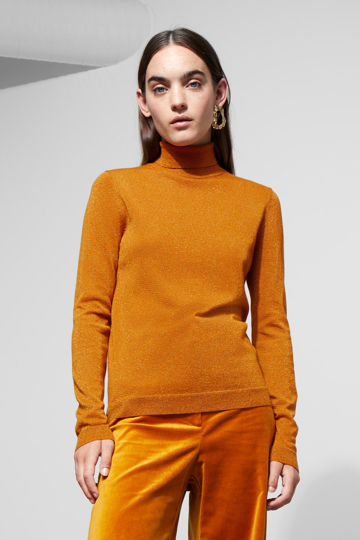 Model front image of Weekday castanet rollneck top in yellow