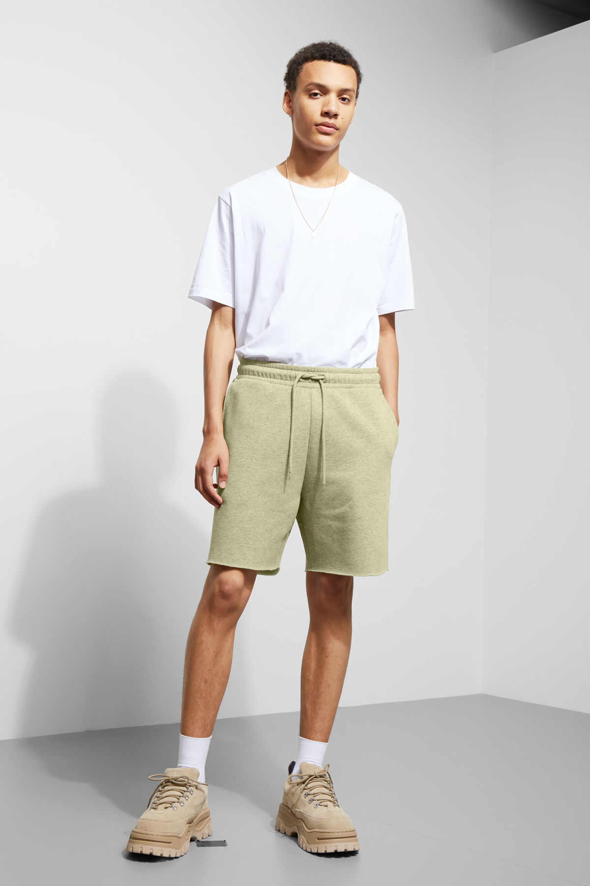 Model front image of Weekday sun jersey shorts in yellow