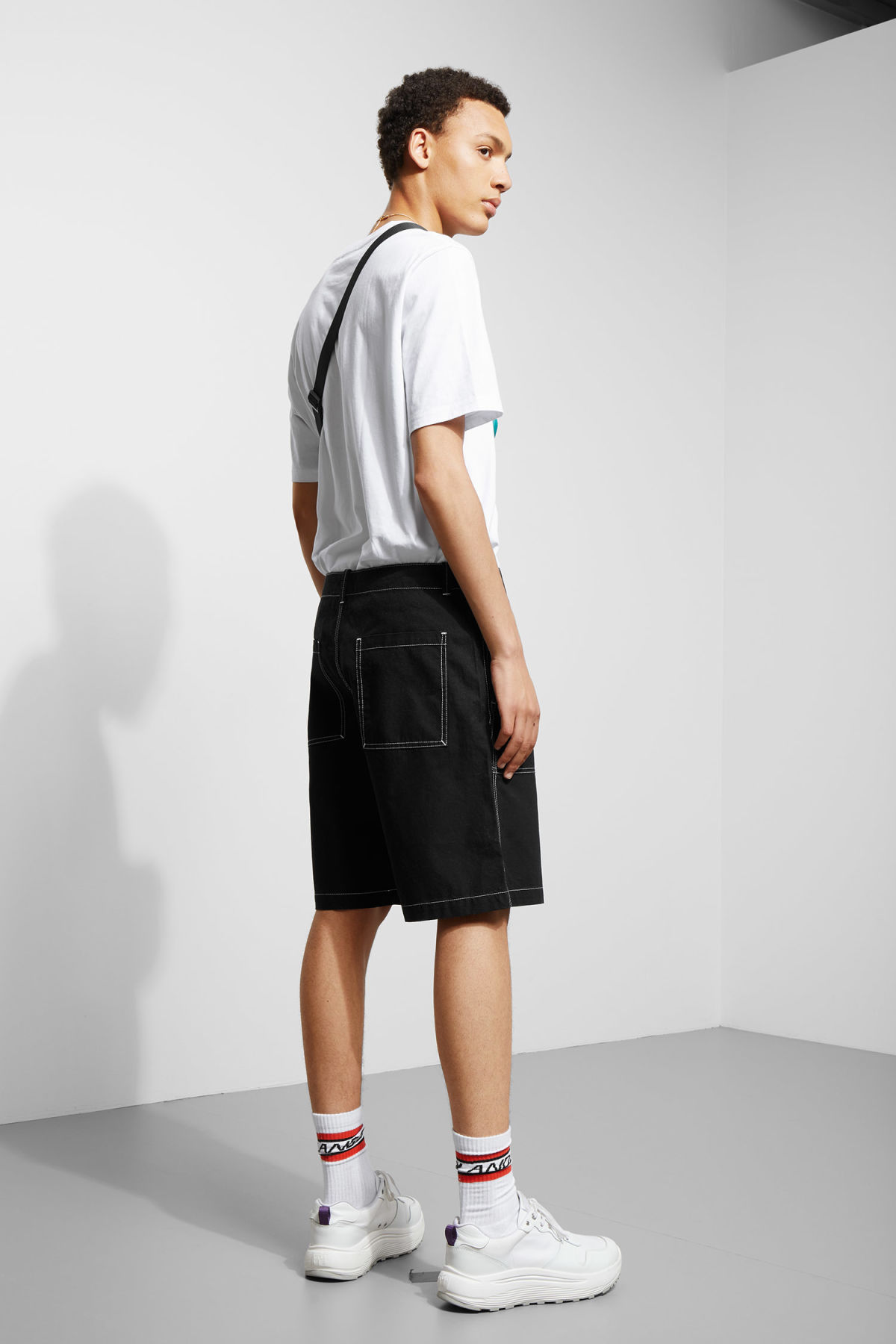 Model back image of Weekday eastside shorts in black