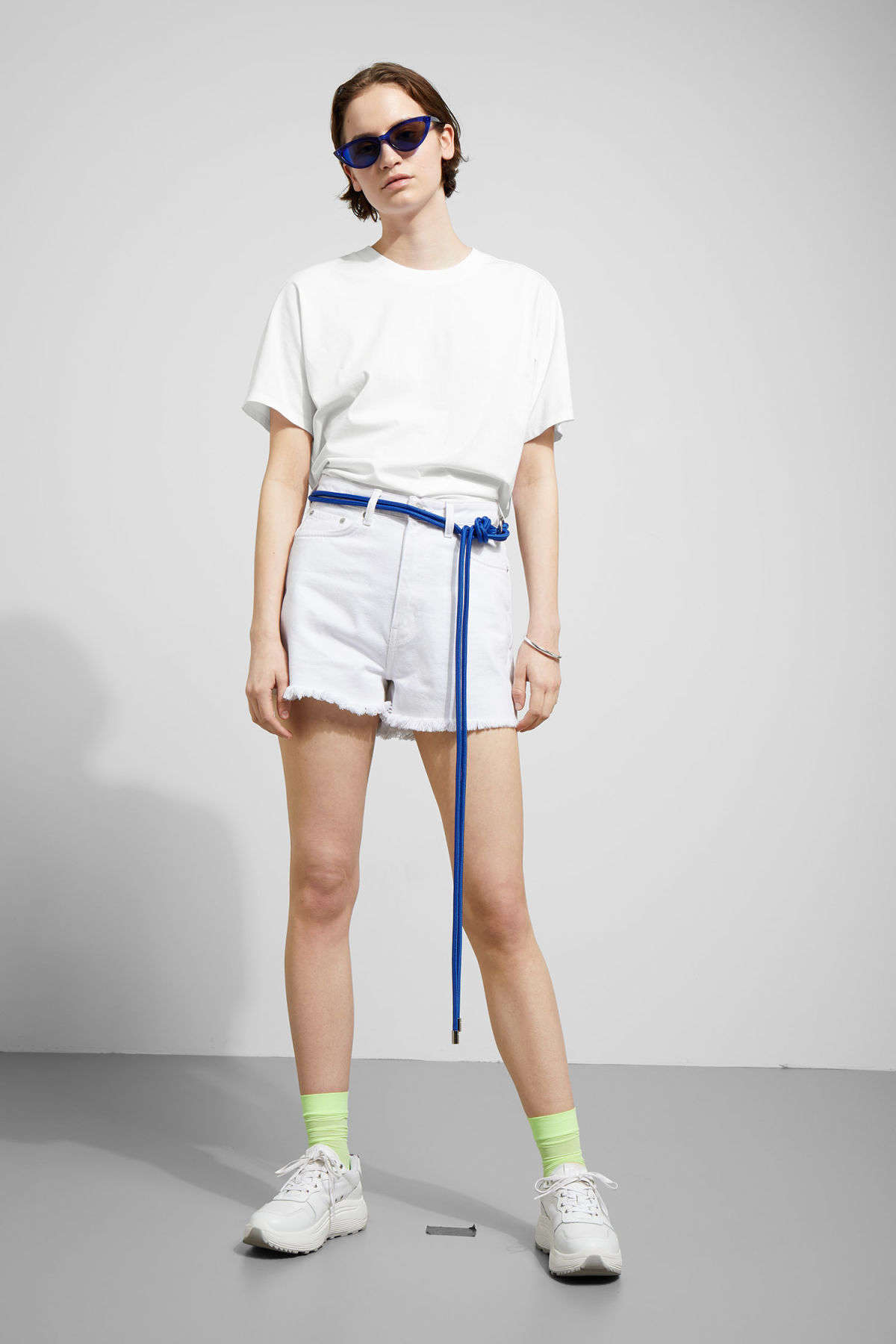 Model side image of Weekday vitrine t-shirt in white