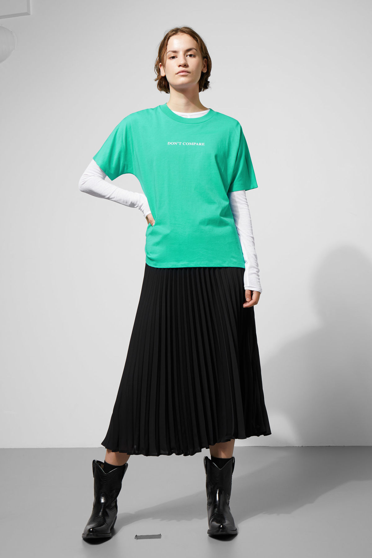 Model side image of Weekday vitrine t-shirt in green