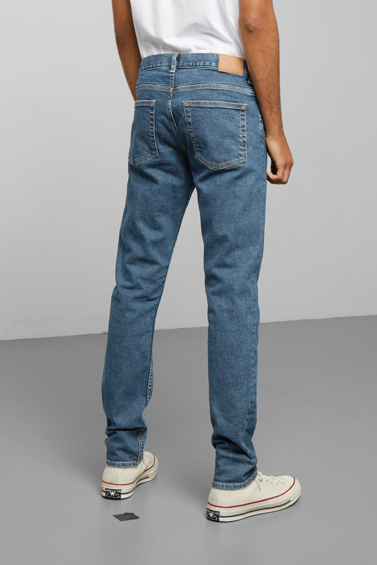 Model side image of Weekday friday denver blue jeans in blue