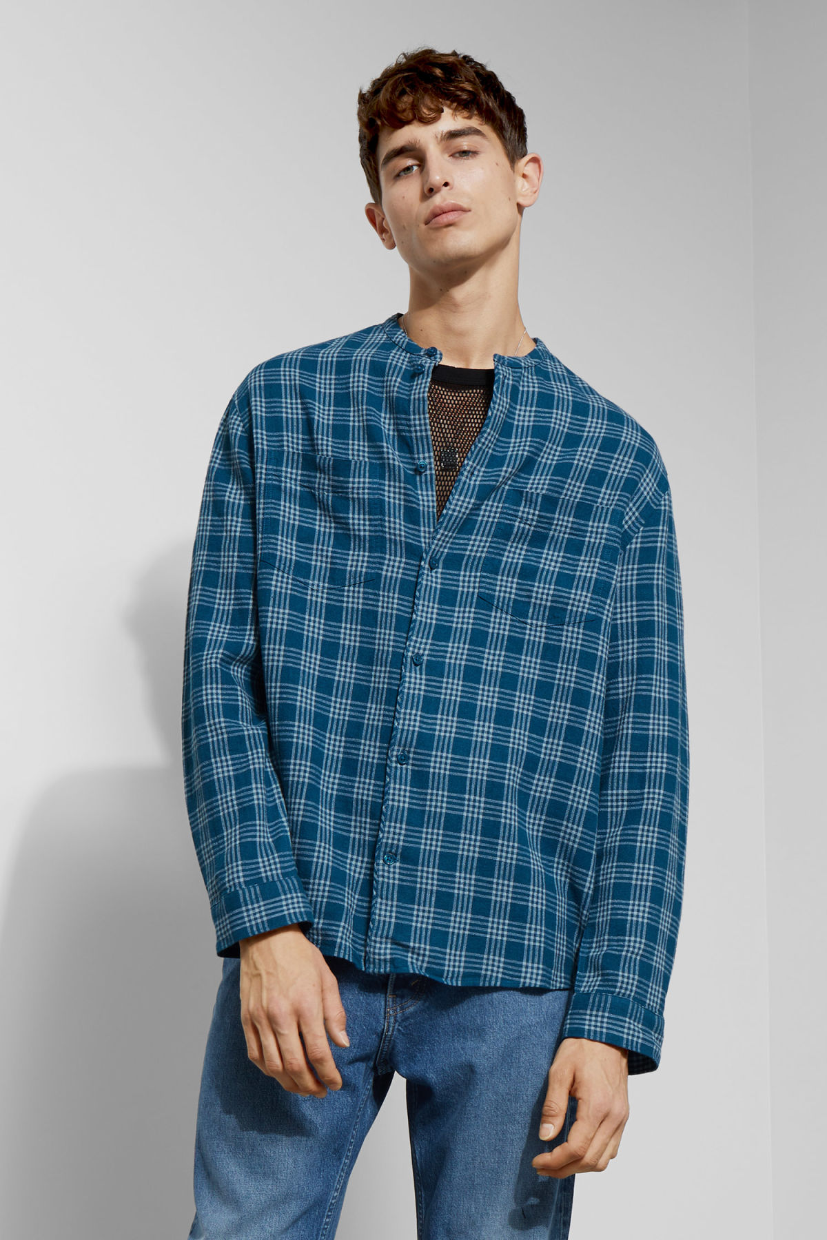Model front image of Weekday curly check linen shirt in blue