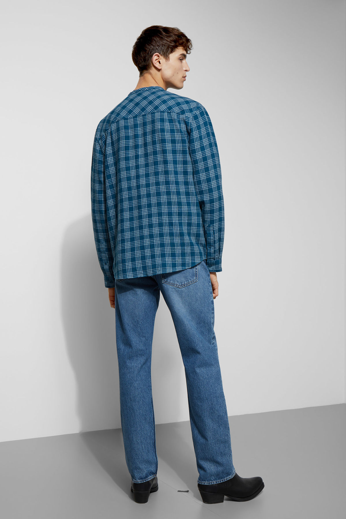Model side image of Weekday curly check linen shirt in blue