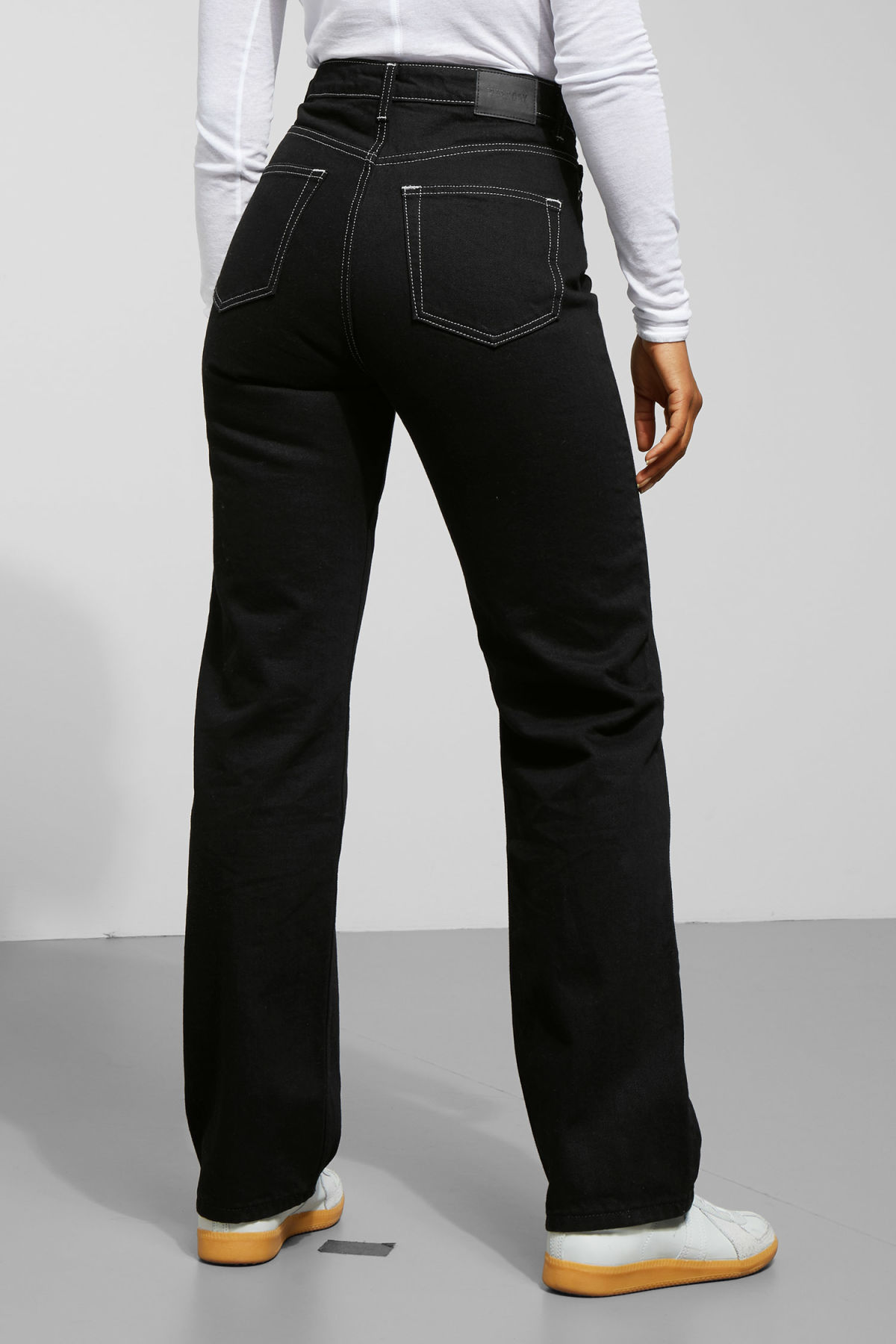 Model side image of Weekday row black jeans in black