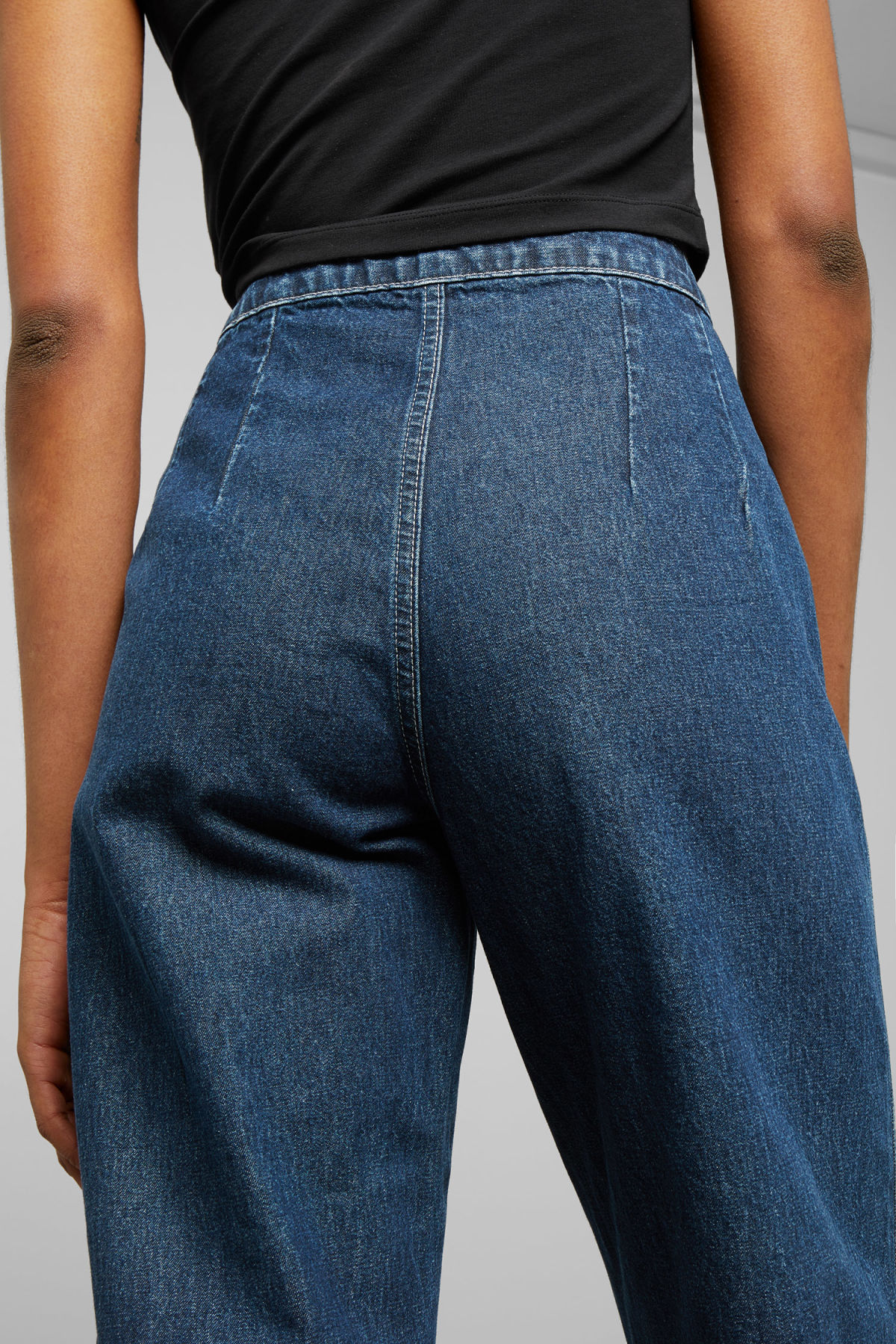 Model side image of Weekday vida denim harbour jeans in blue