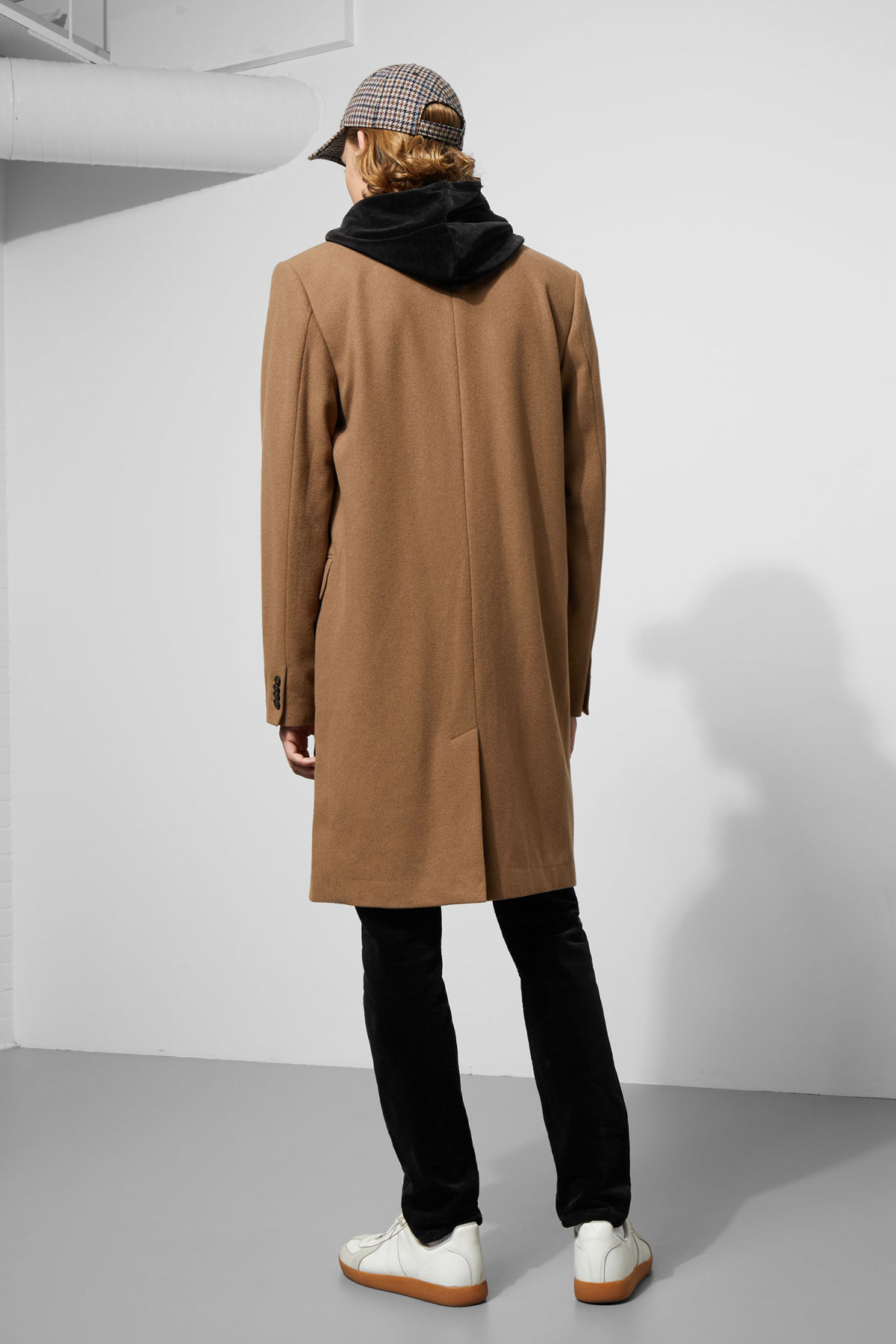 Model side image of Weekday spencer coat in yellow