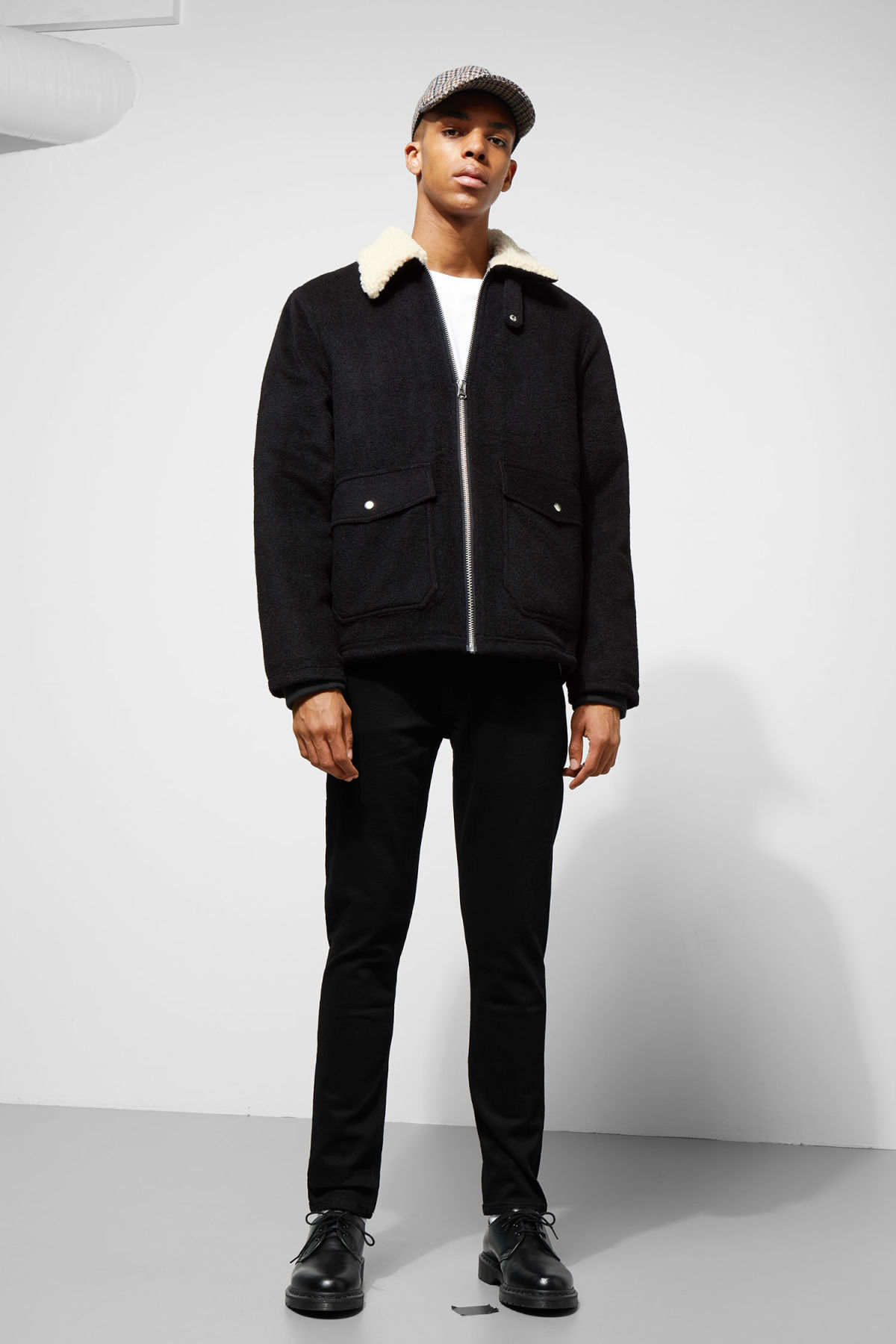 Model side image of Weekday justus jacket in black