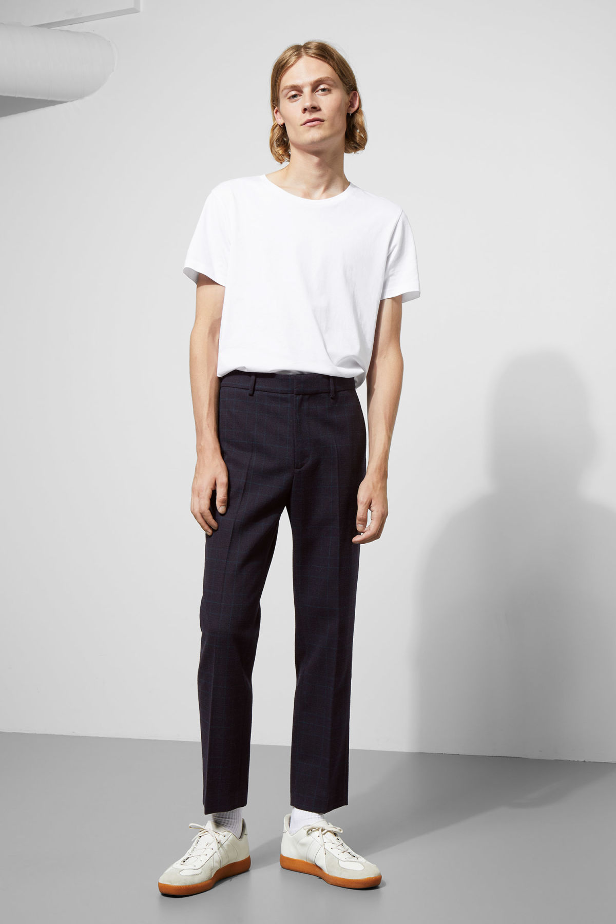 Model front image of Weekday charlie checked trousers in blue