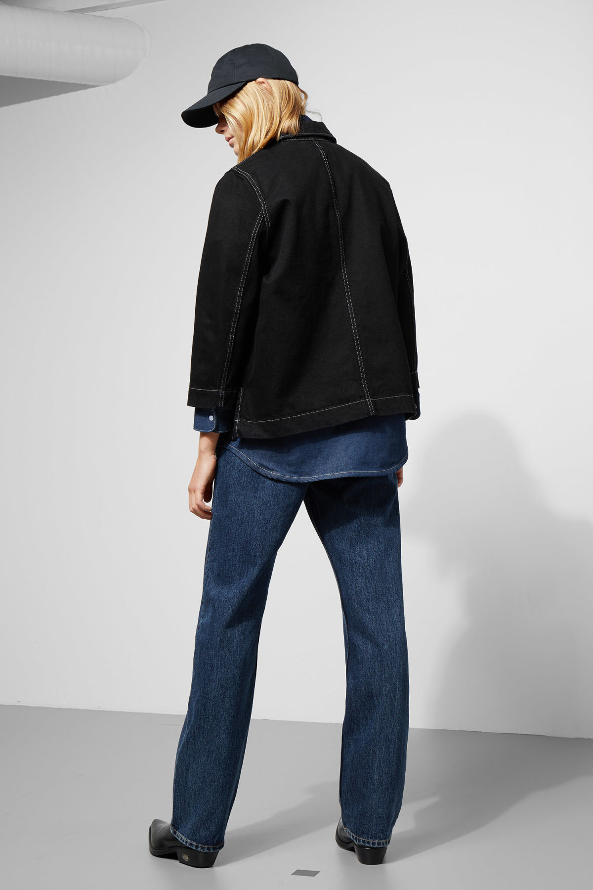 Model side image of Weekday trip black denim jacket in black
