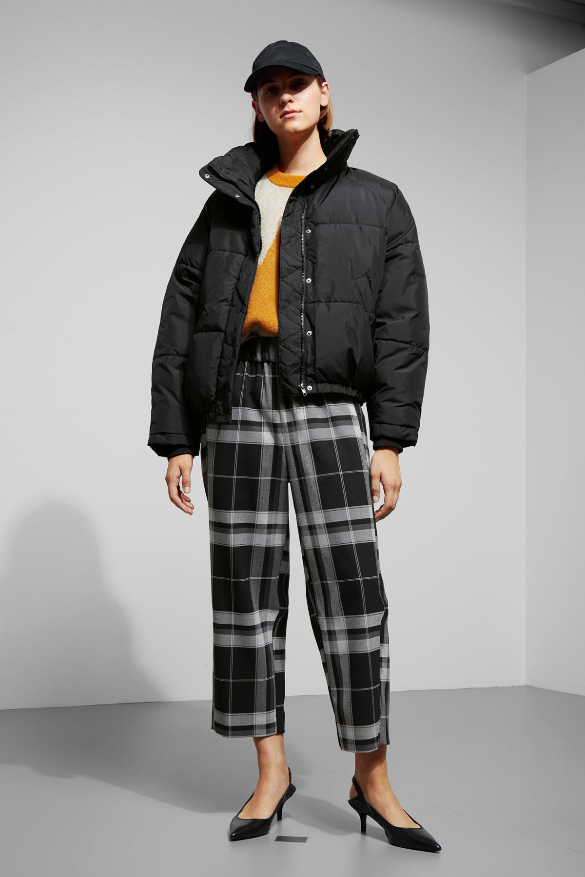 Model side image of Weekday cyntia puffer jacket in black