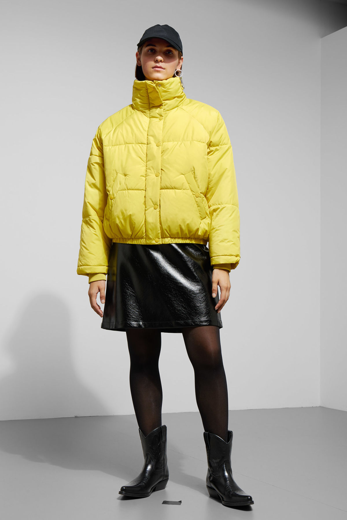 Model side image of Weekday cyntia puffer jacket in yellow