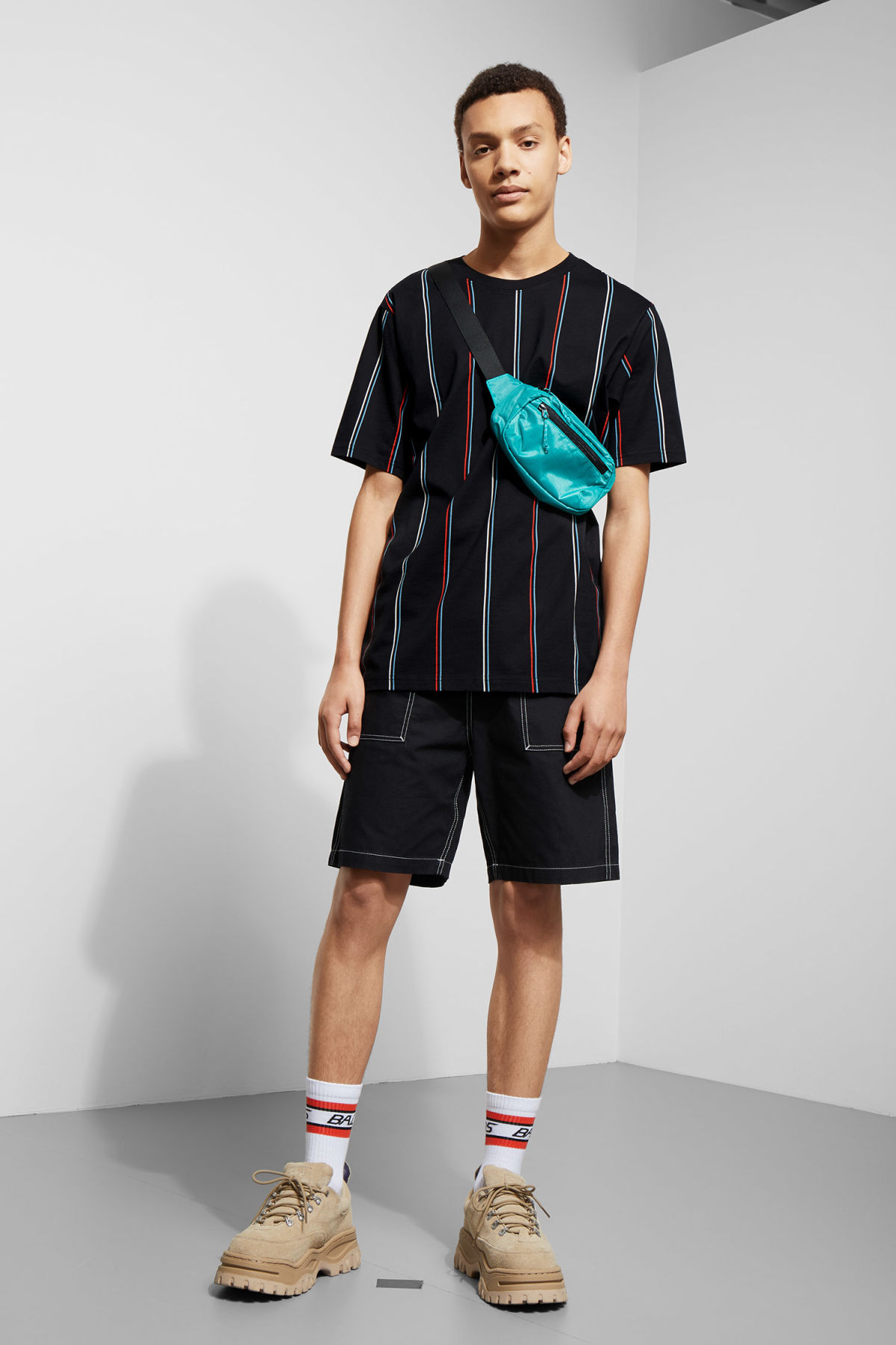 Model side image of Weekday frank vertical t-shirt in black