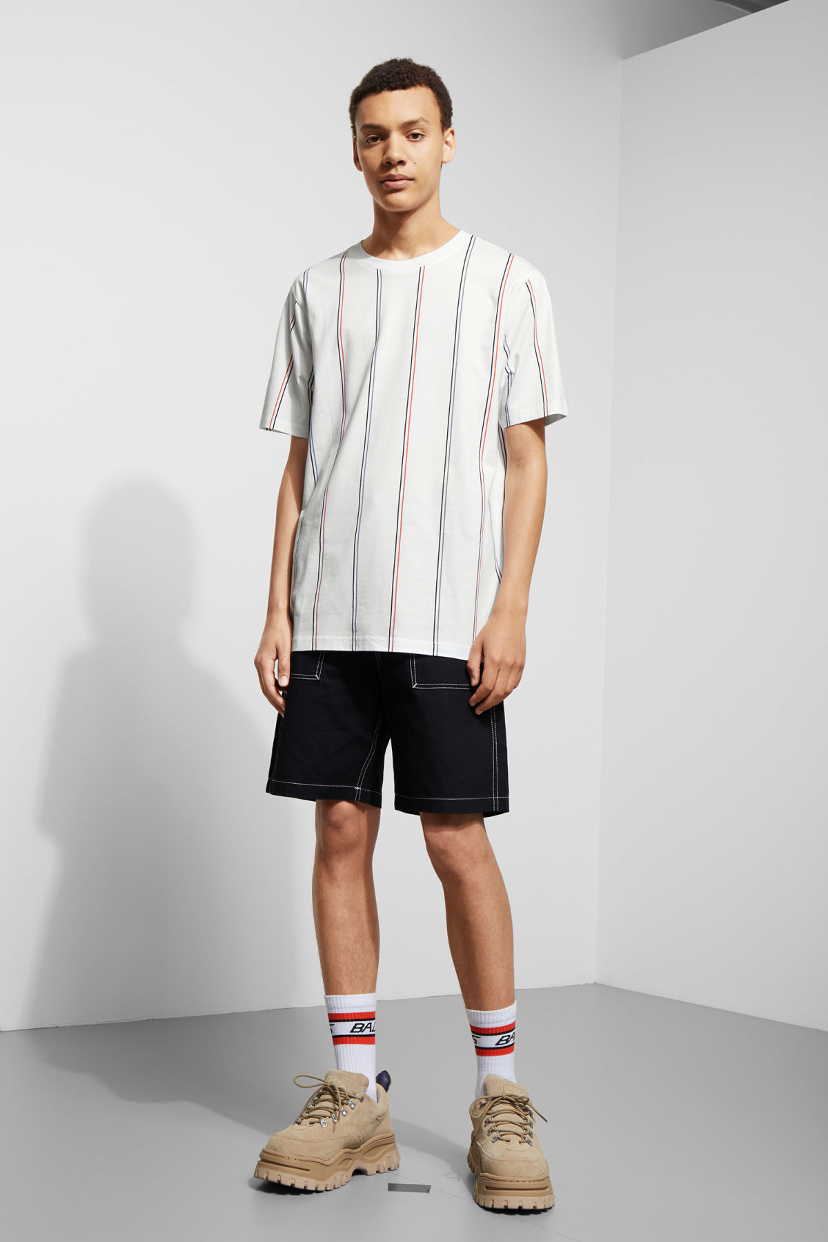 Model side image of Weekday frank vertical t-shirt in white