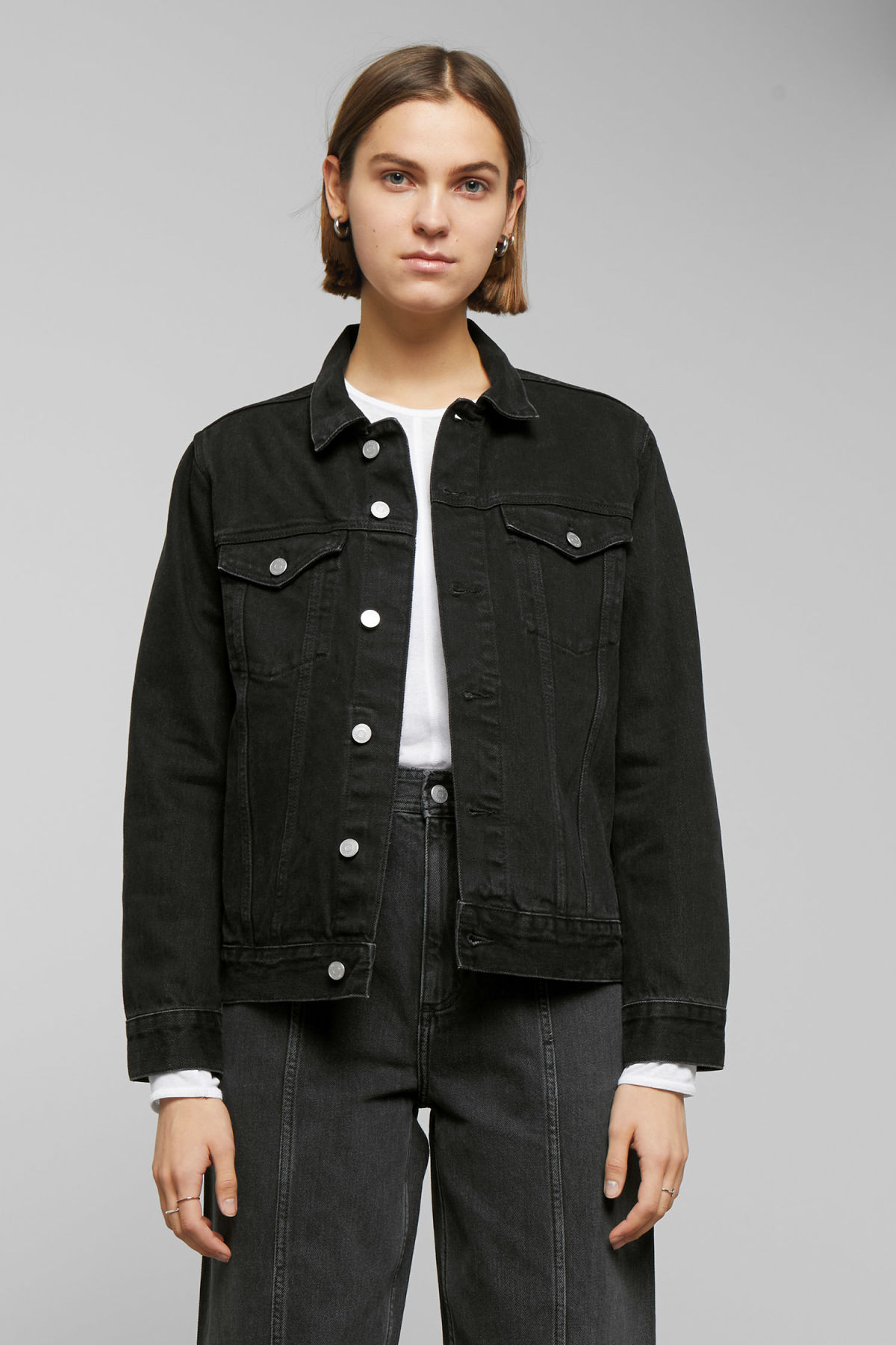 Model side image of Weekday single tuned black jacket in black