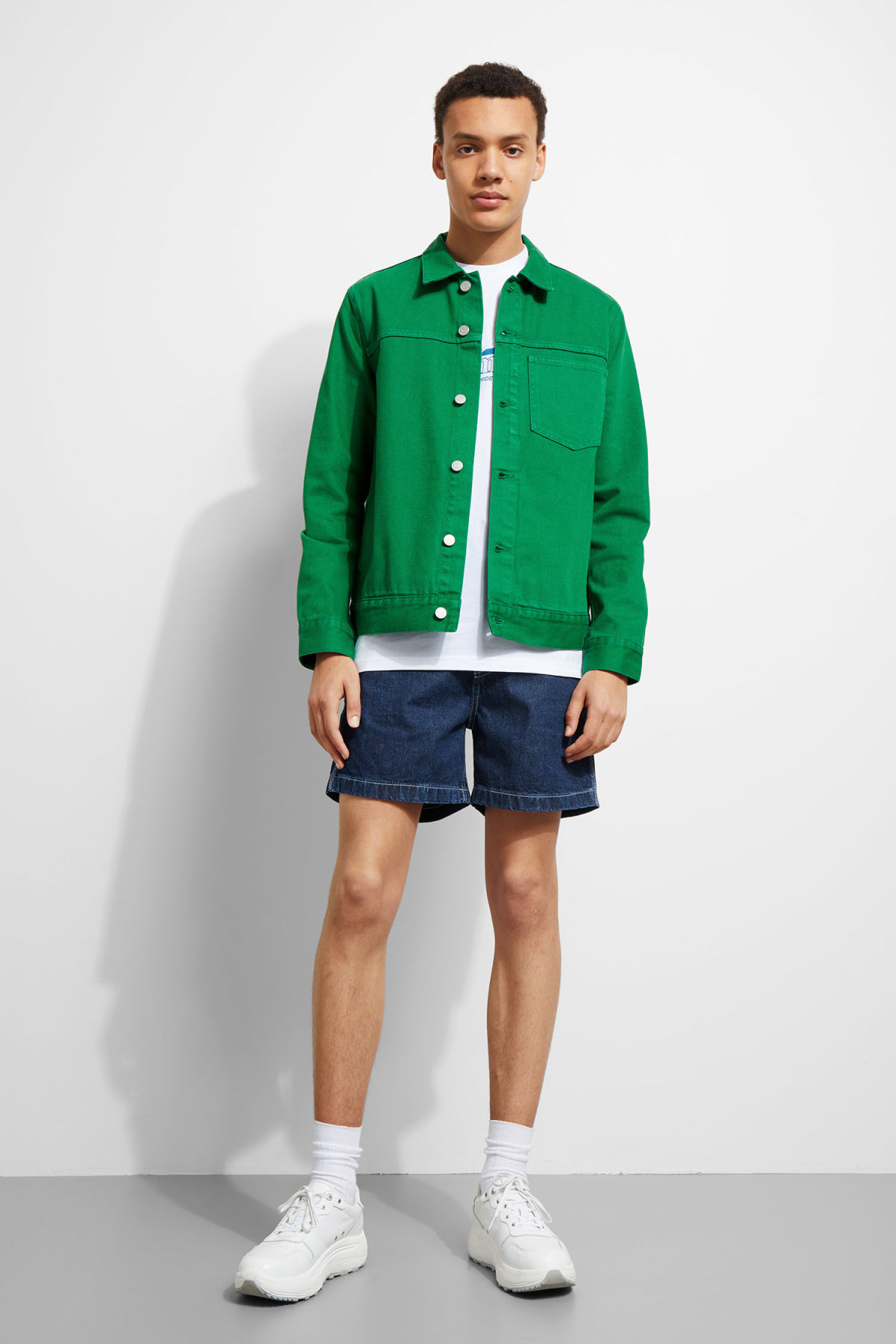 Model side image of Weekday core green jacket in green