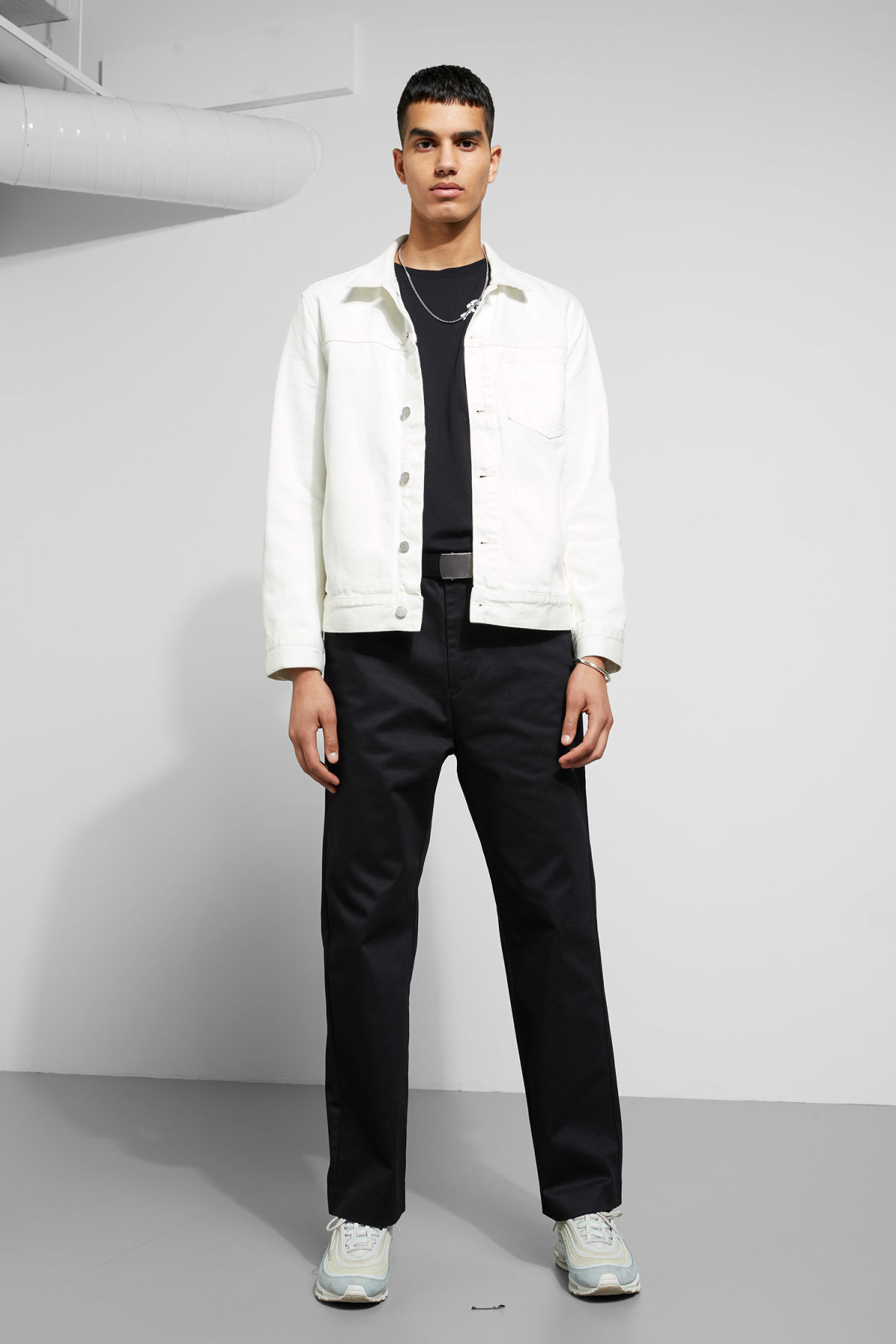 Model side image of Weekday core off white jacket  in white