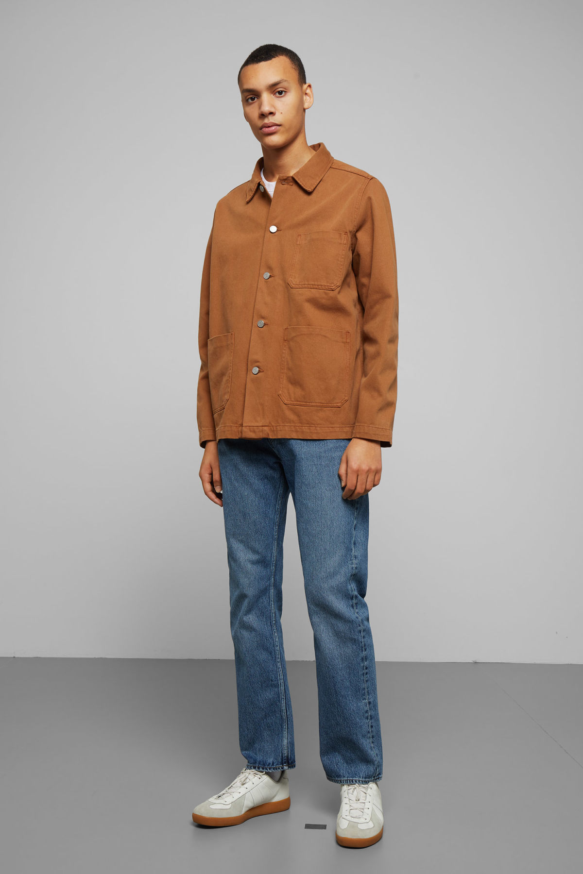 Model side image of Weekday generic tobacco jacket  in orange