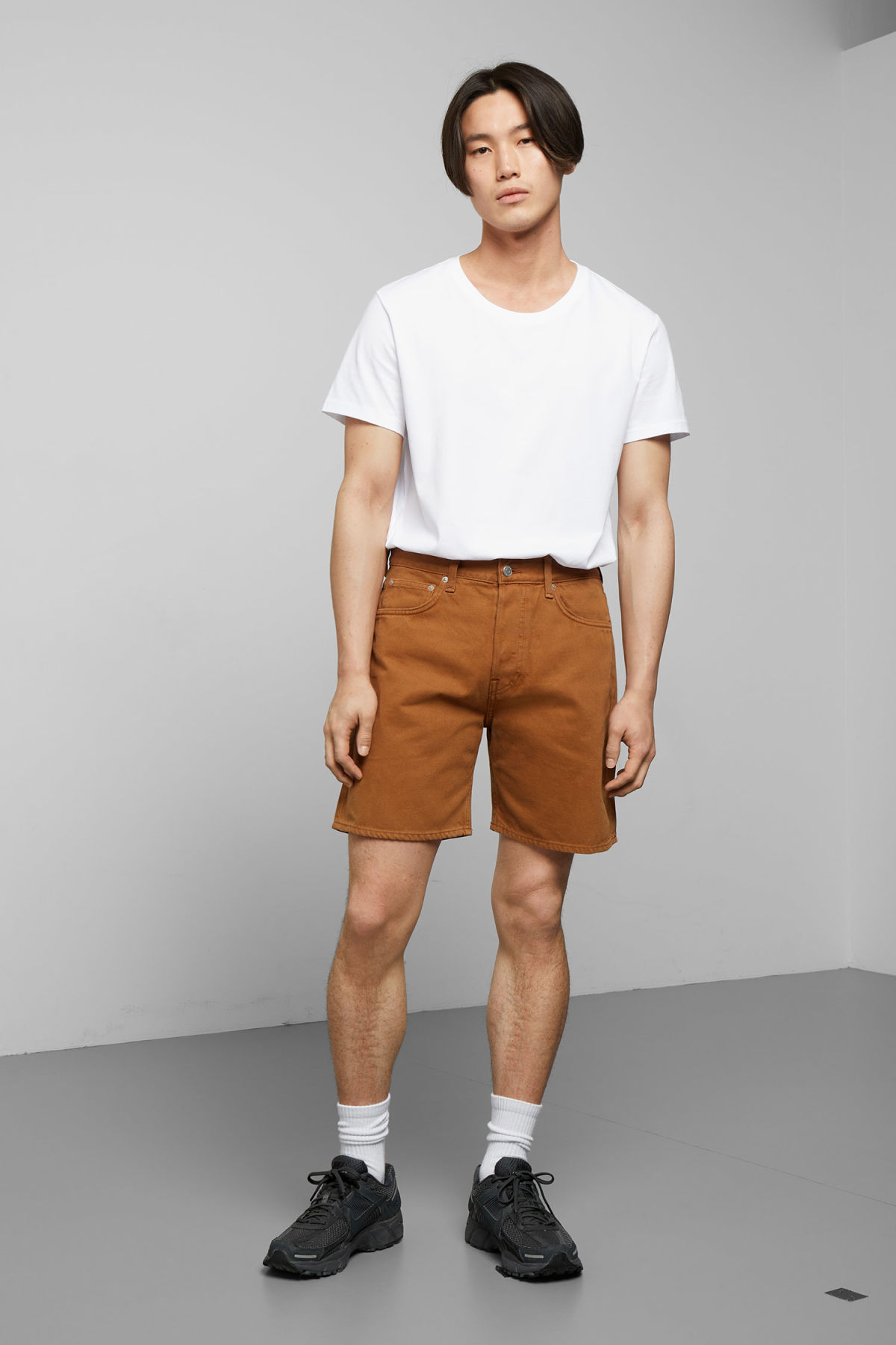 Model front image of Weekday vacant tobacco shorts in orange