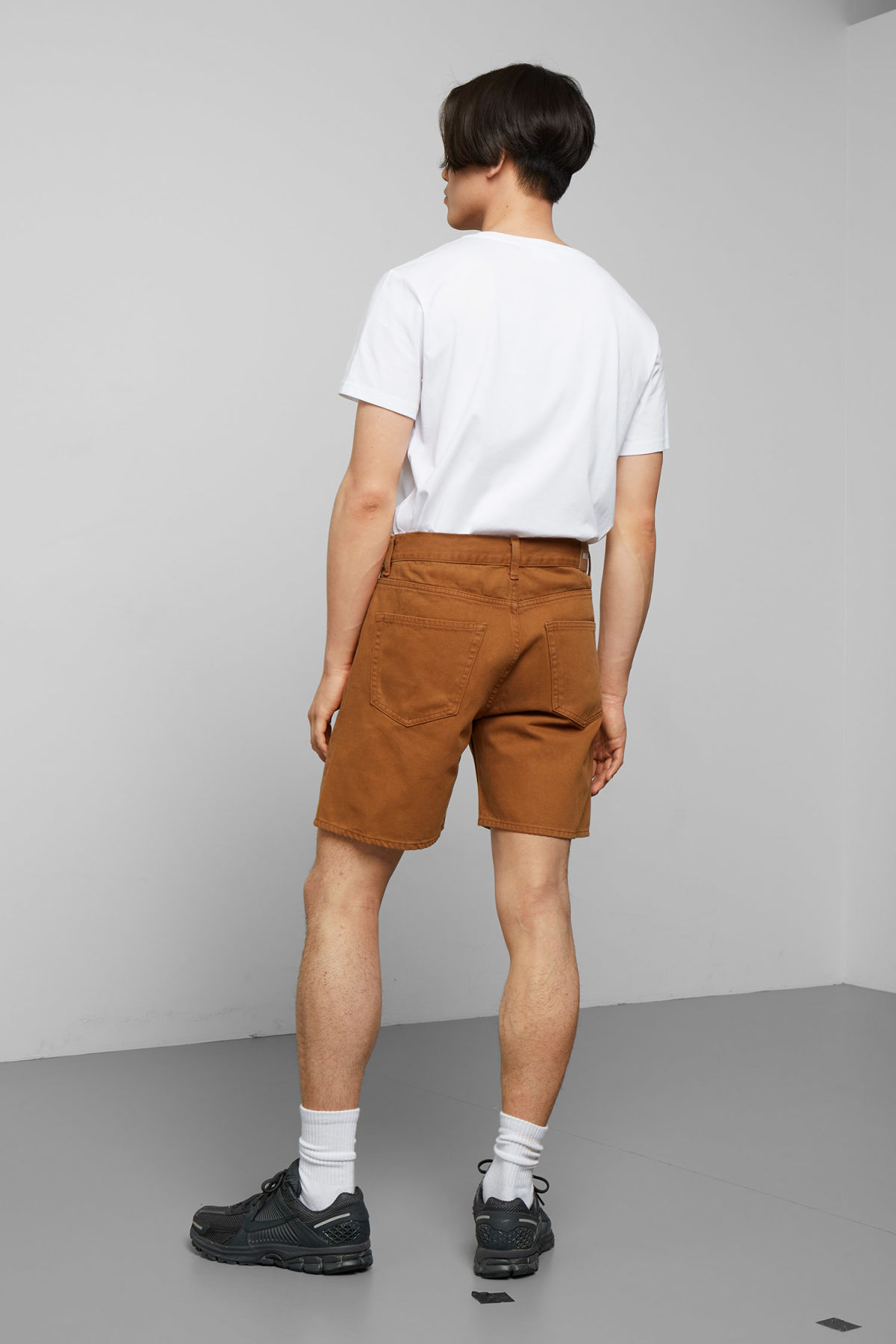 Model back image of Weekday vacant tobacco shorts in orange