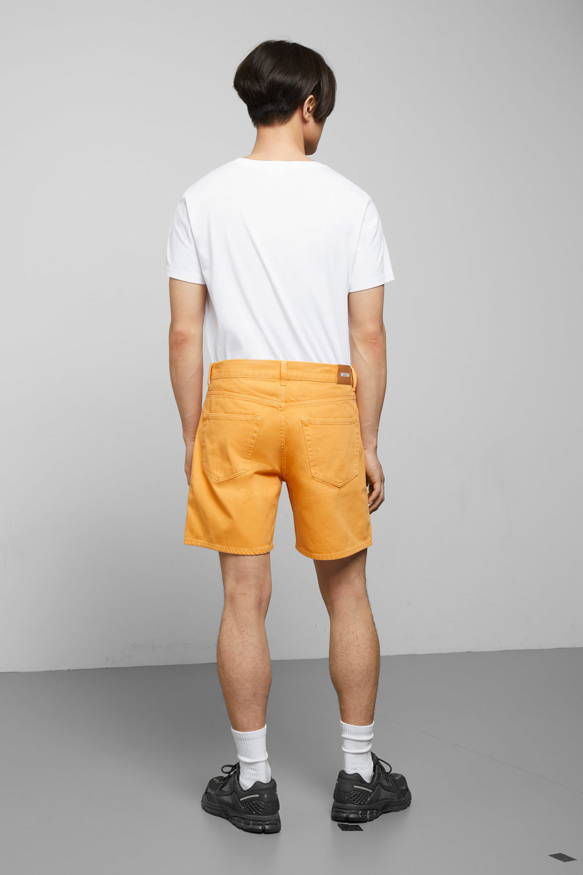 Model side image of Weekday vacant yellow shorts in yellow