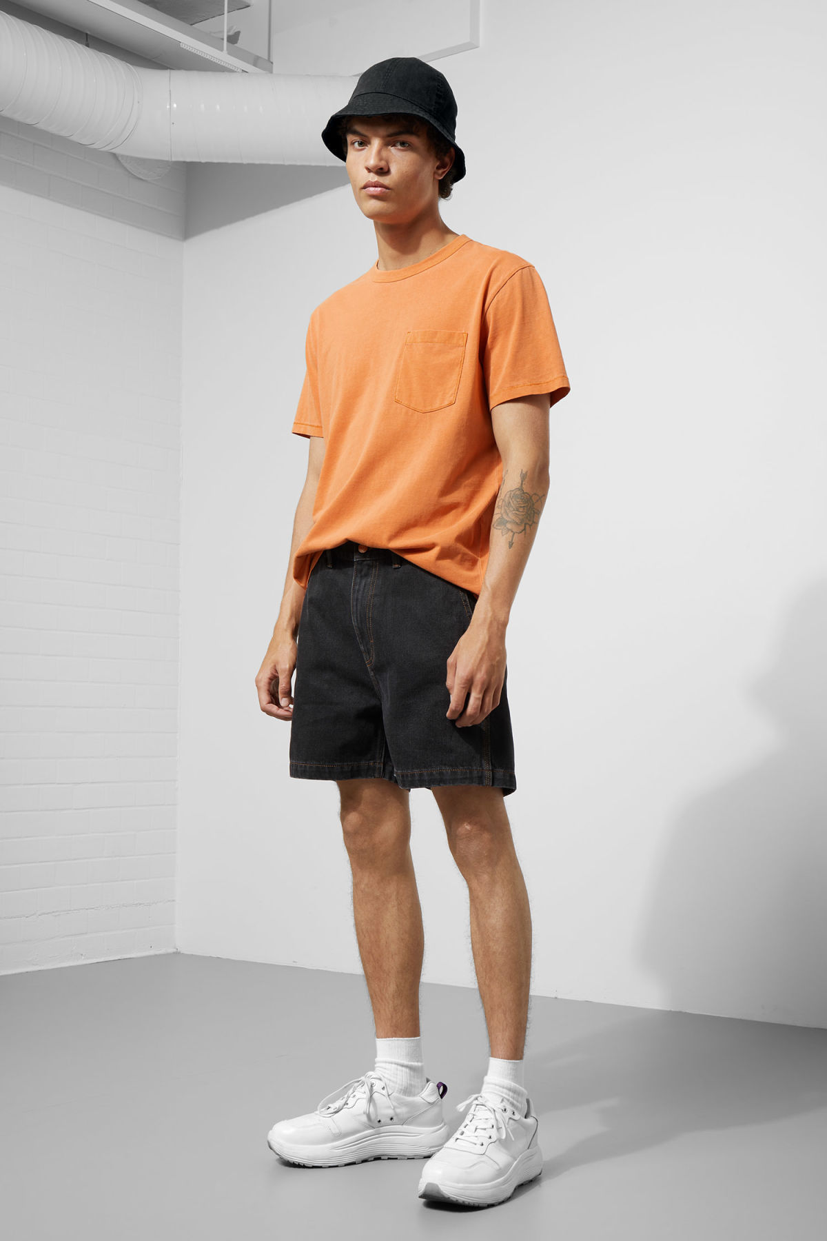 Model front image of Weekday coin tuned black shorts  in black