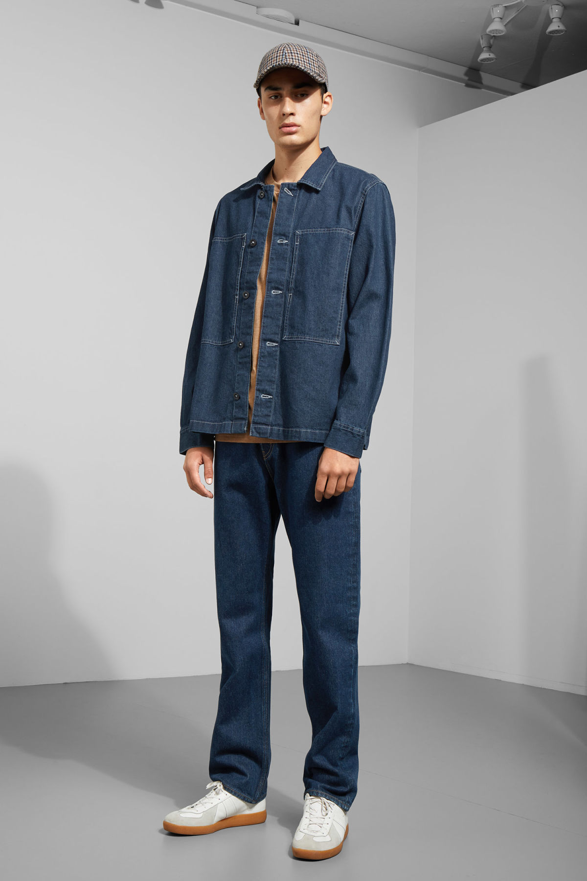 Model side image of Weekday ran billy blue denim shirt in blue