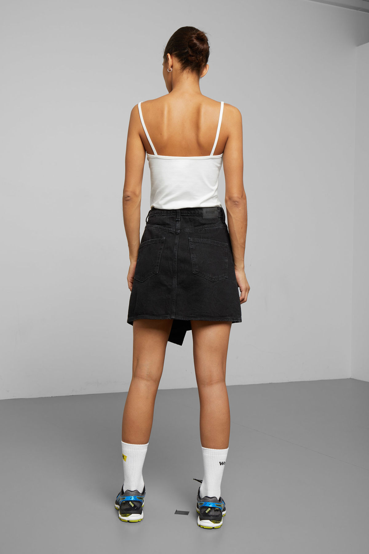 Model back image of Weekday newa denim skirt in black
