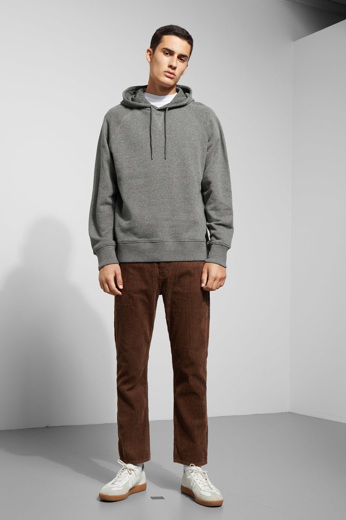 Model side image of Weekday tom neps hoodie in grey