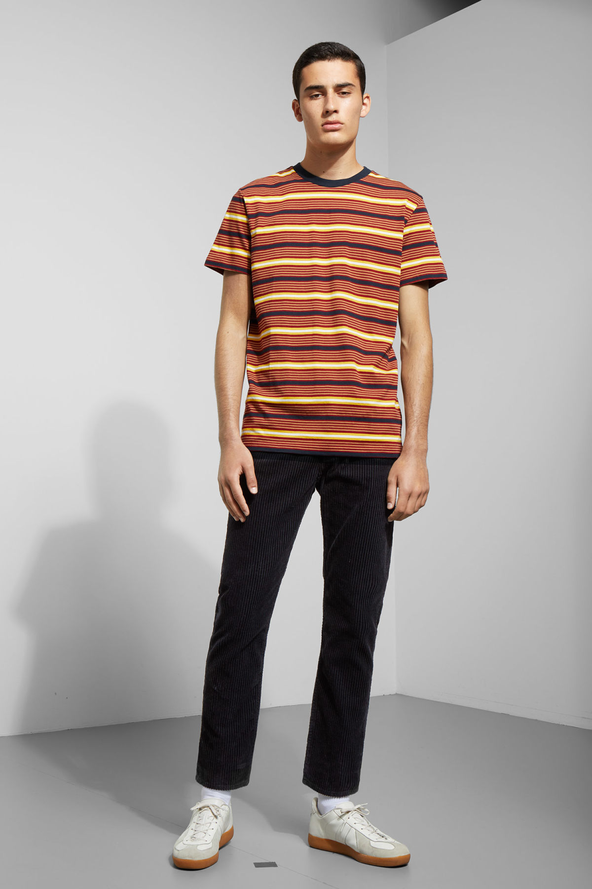Model side image of Weekday alan stripe t-shirt in red