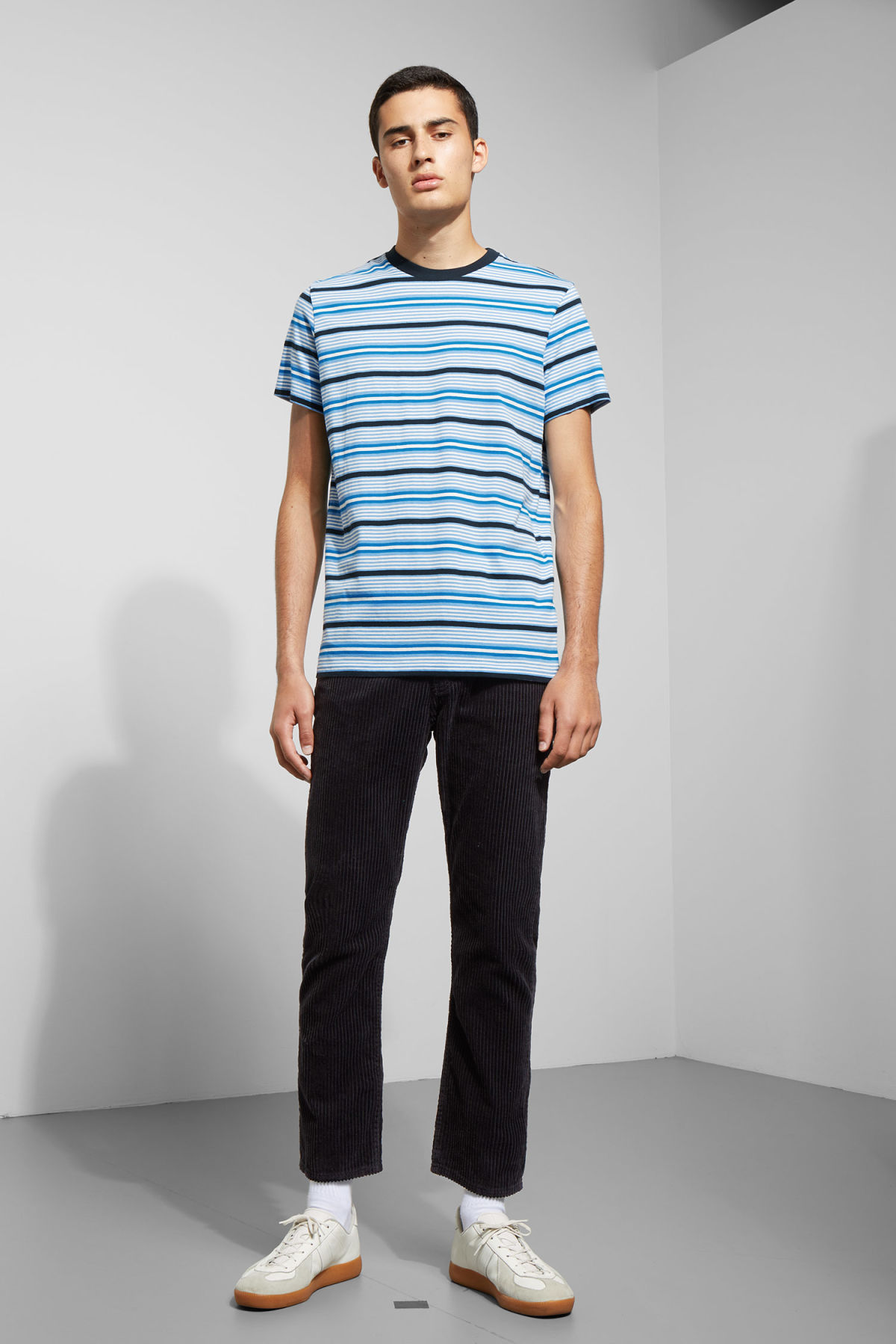 Model side image of Weekday alan stripe t-shirt in blue