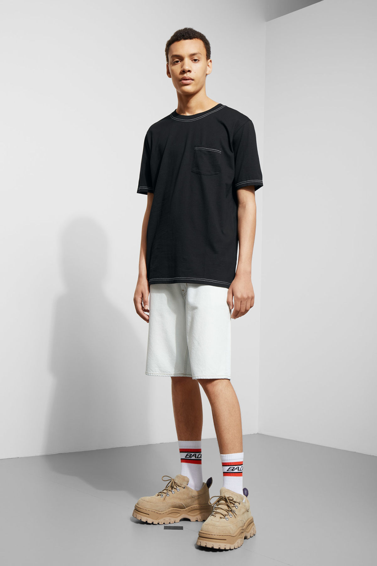 Model side image of Weekday kingston t-shirt in black