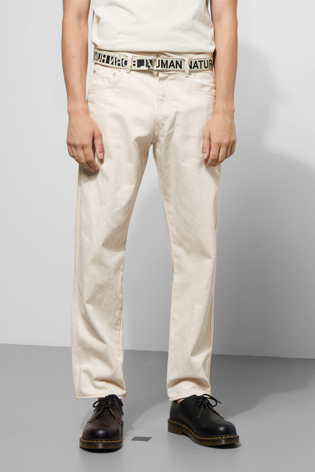 Model side image of Weekday tennesse ecru denim trousers in beige