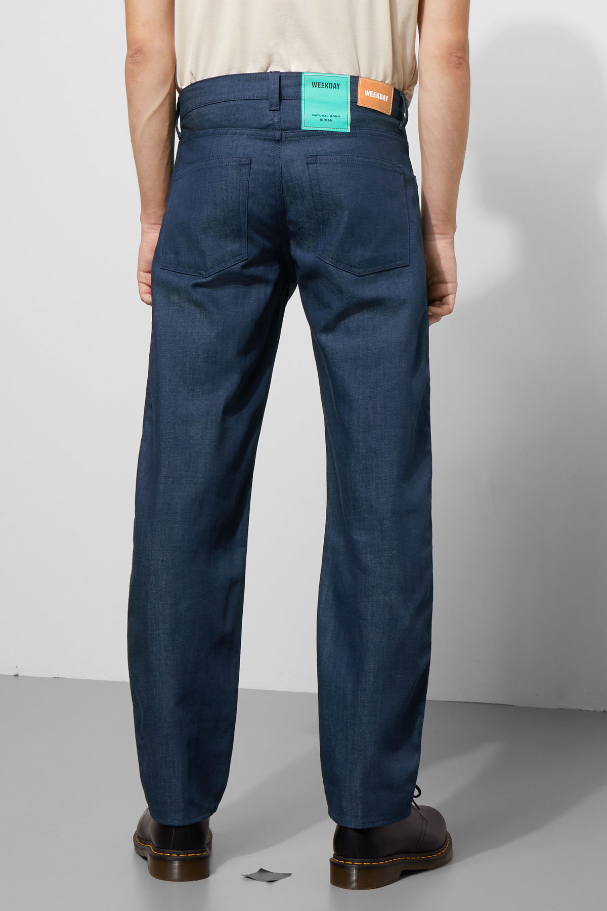Model back image of Weekday tennesse raw denim trousers in blue