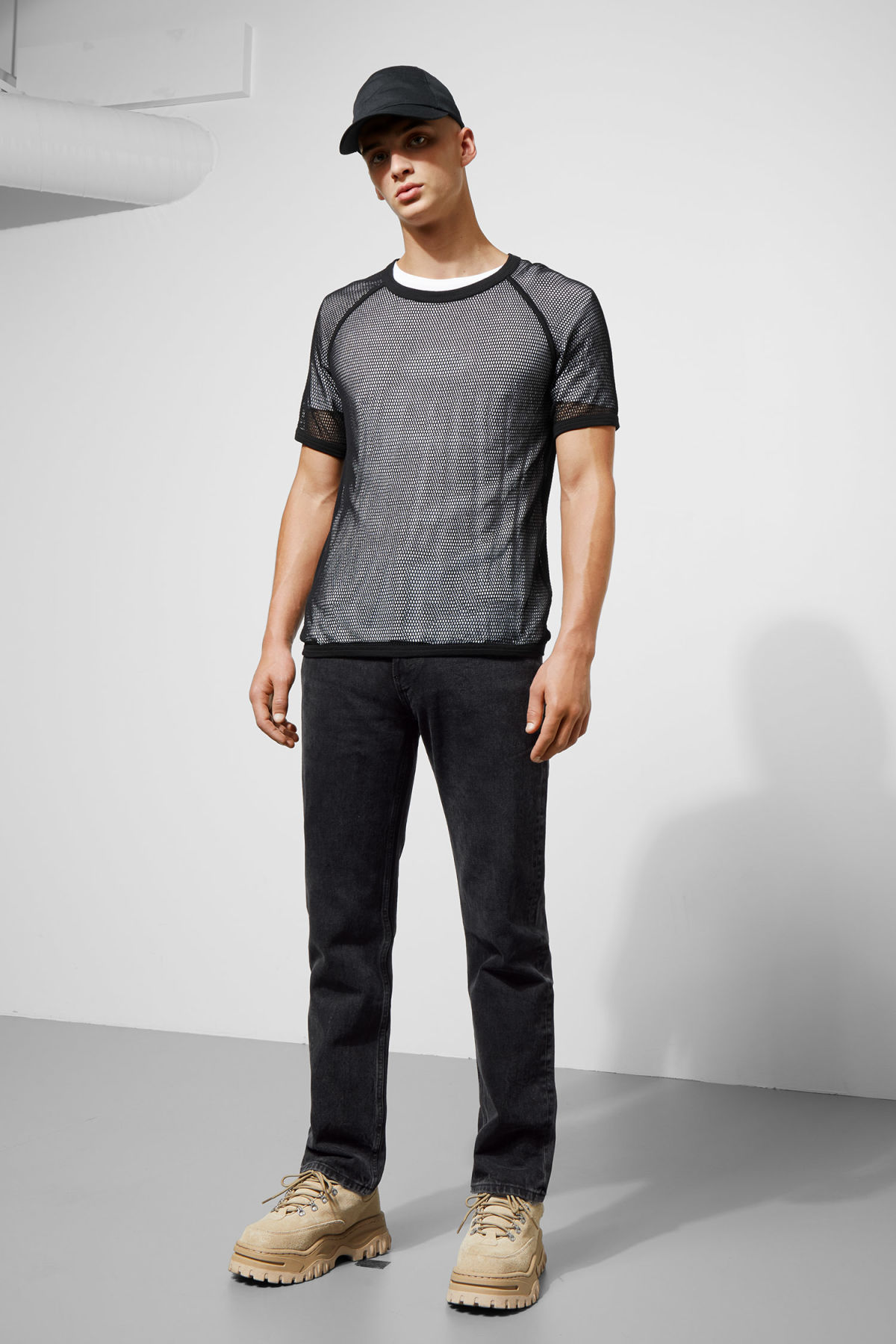 Model side image of Weekday liam mesh t-shirt in black
