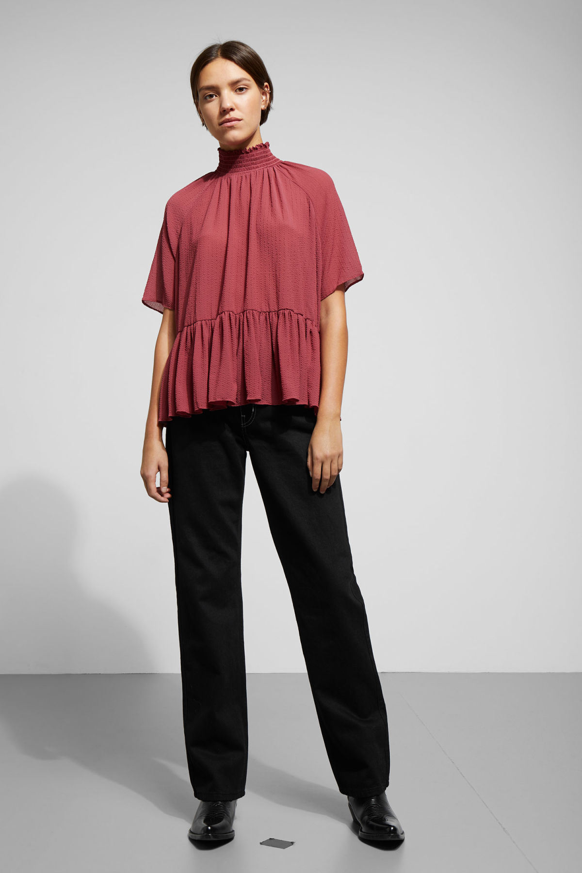 Model side image of Weekday garden blouse in red