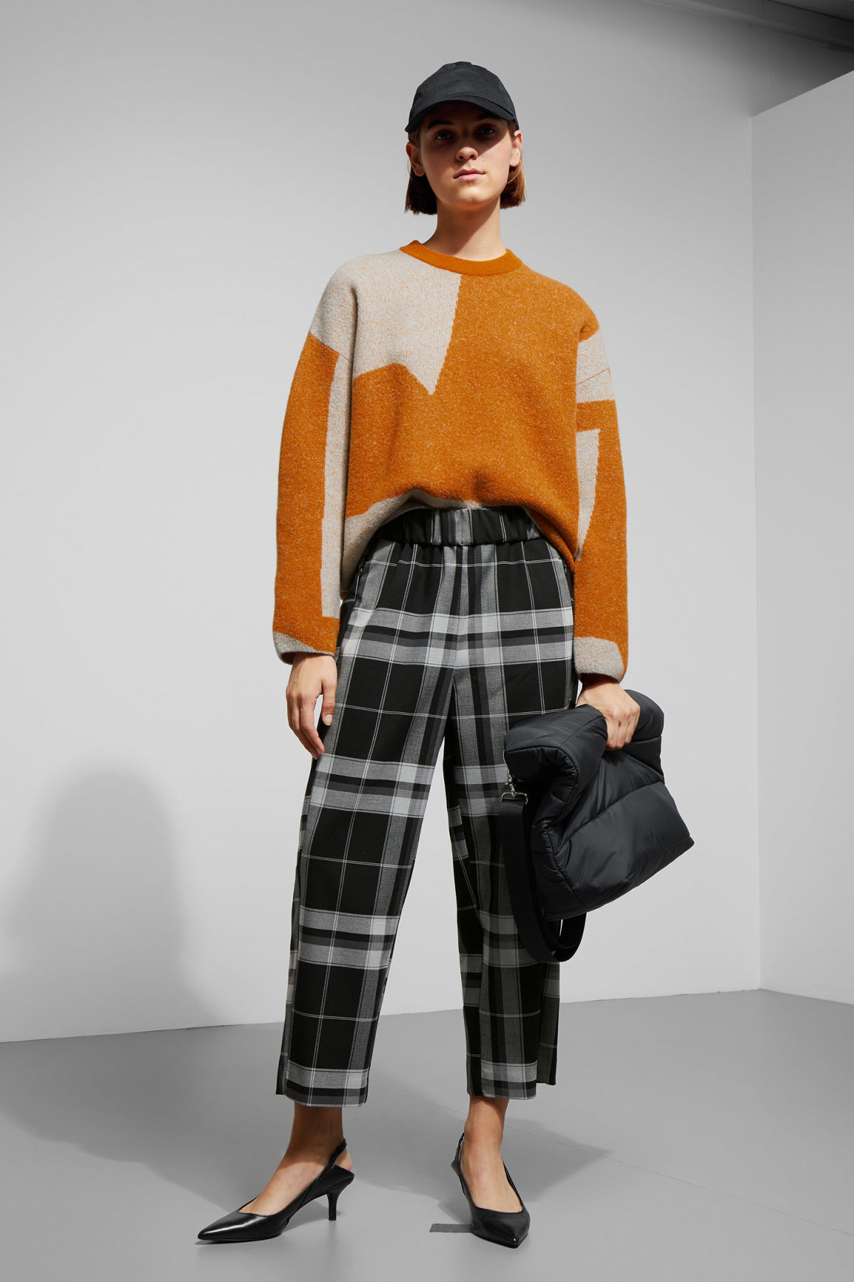 Model side image of Weekday cloe jacquard sweater in orange