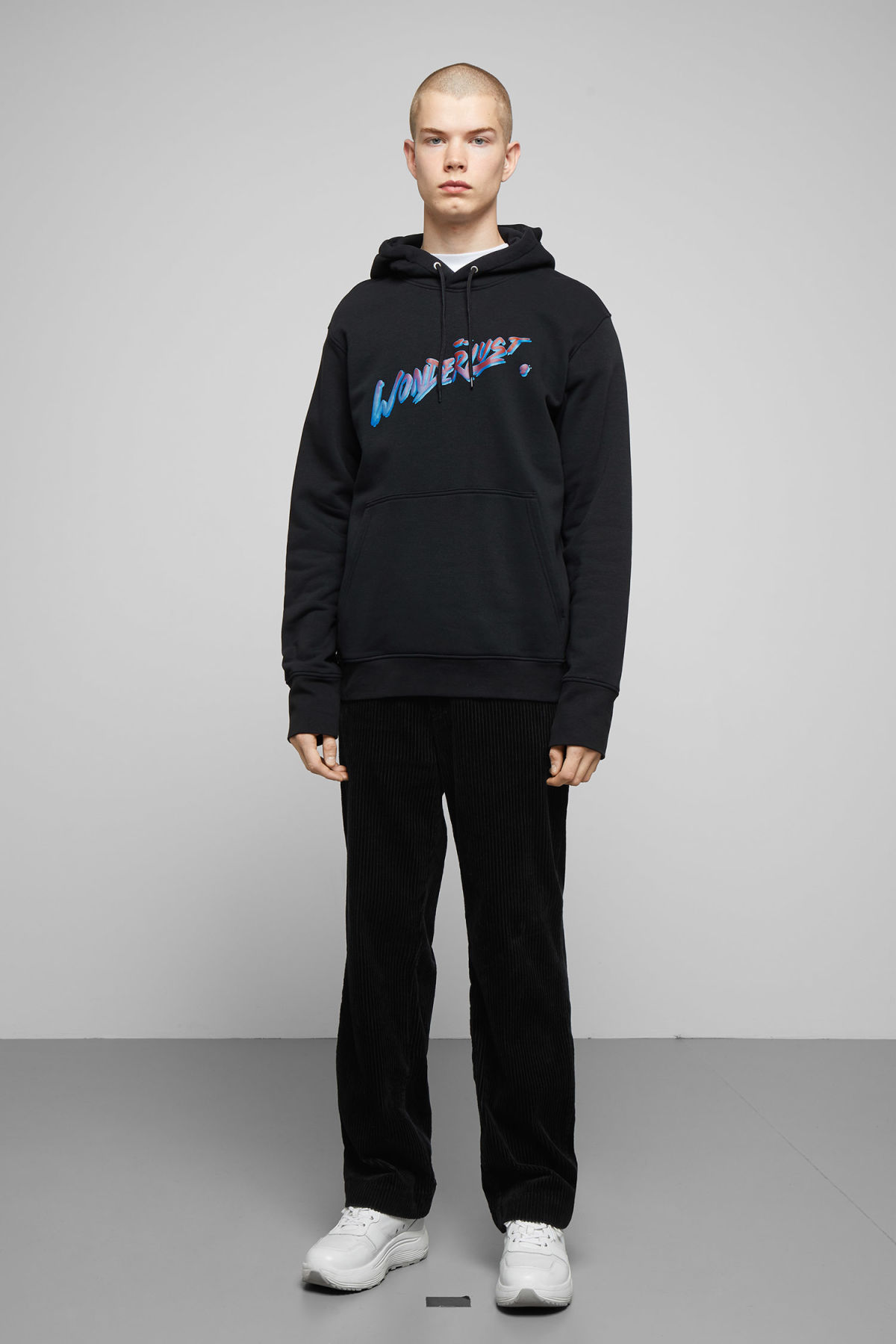 Model side image of Weekday hawk wonderlust hoodie in black