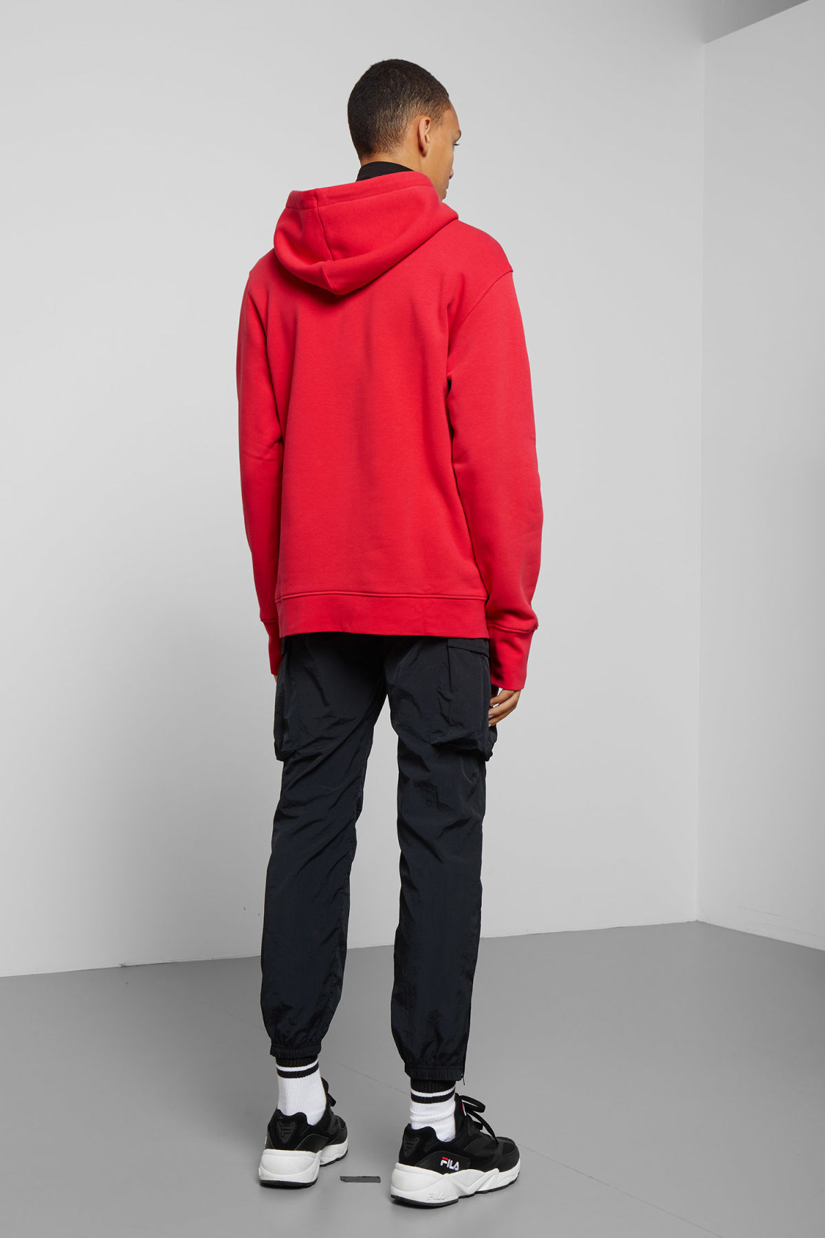 Model side image of Weekday hawk wonderlust hoodie in red