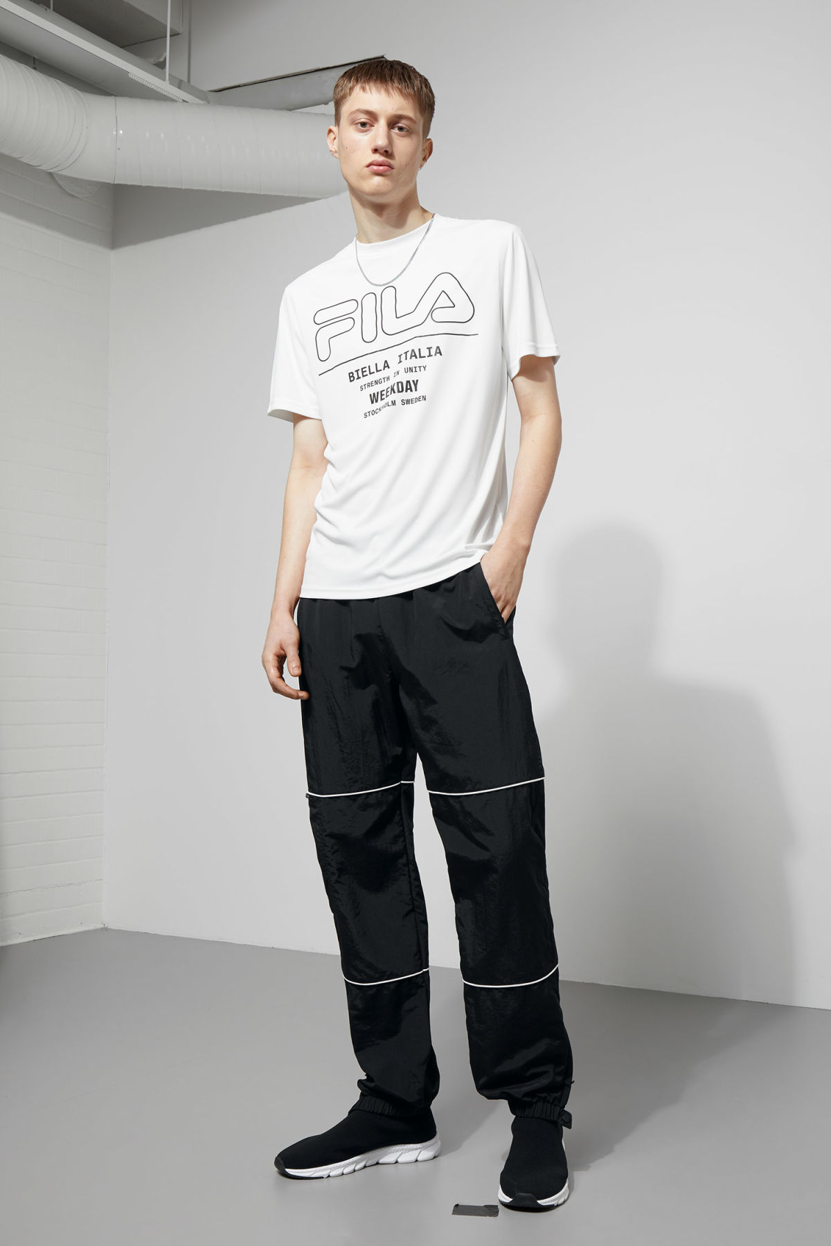 Model side image of Weekday noto tee in white