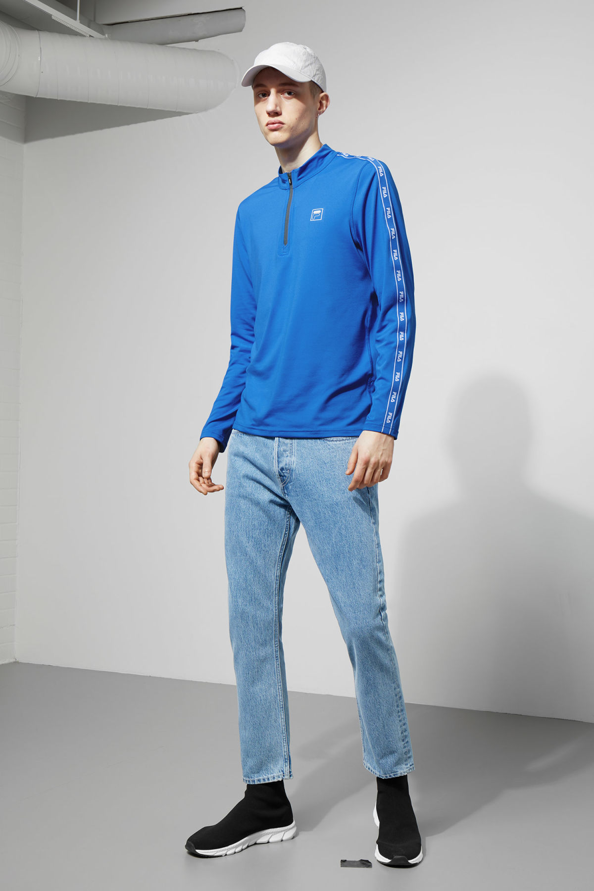 Model side image of Weekday imola zip sweatshirt in blue