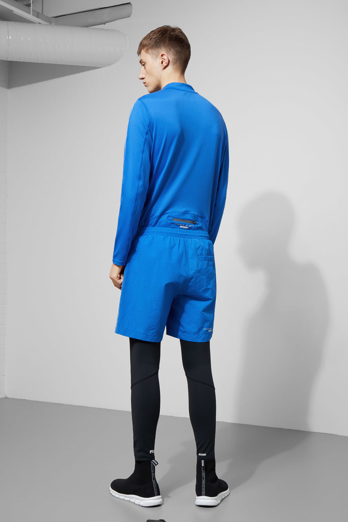 Model back image of Weekday monza shorts in blue