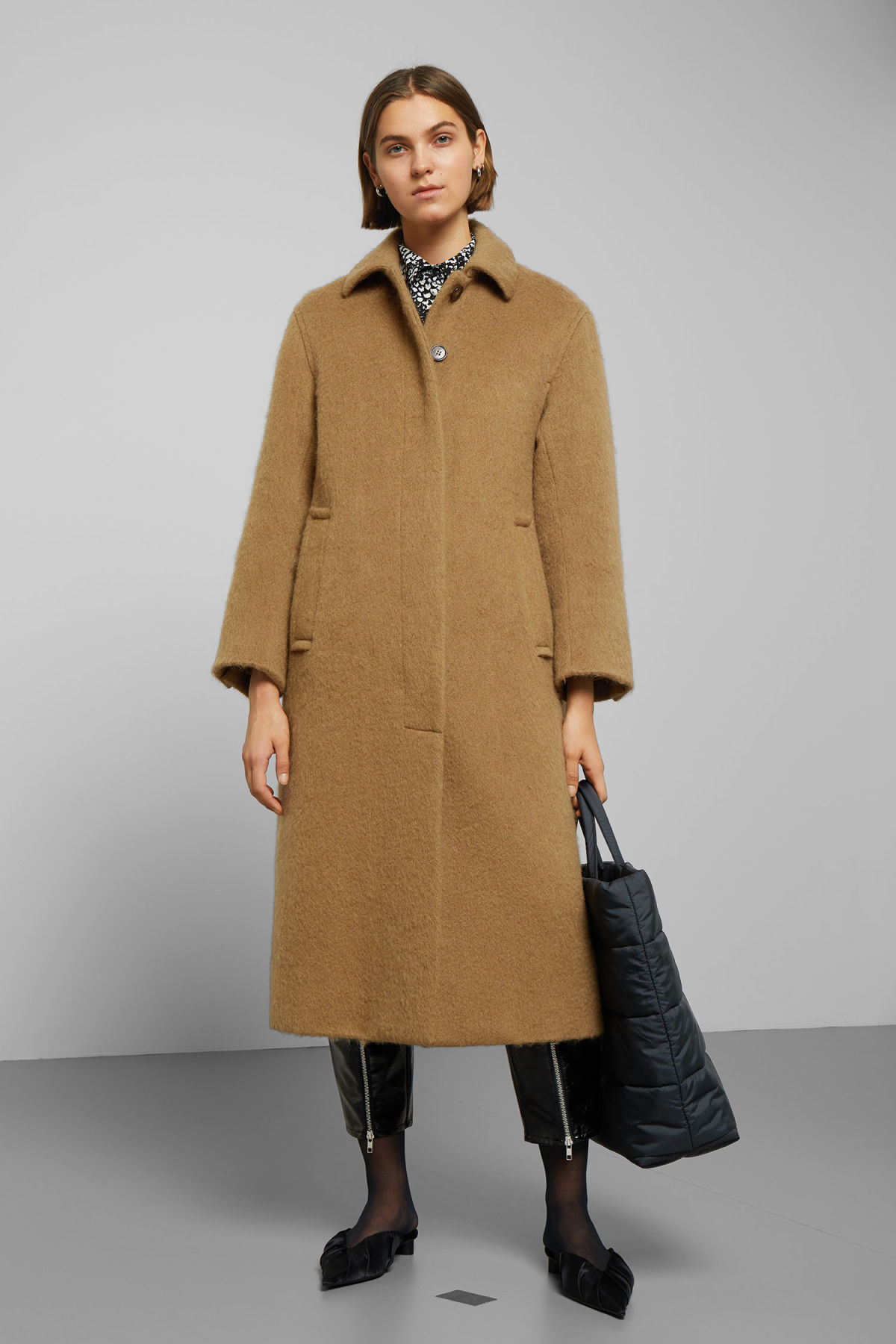 Model side image of Weekday zoe coat in beige