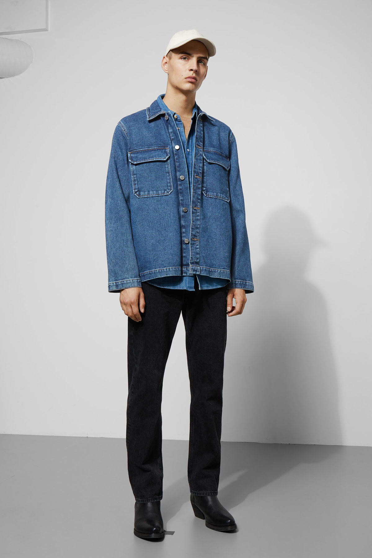 Model side image of Weekday mira 20 blue denim shirt in blue