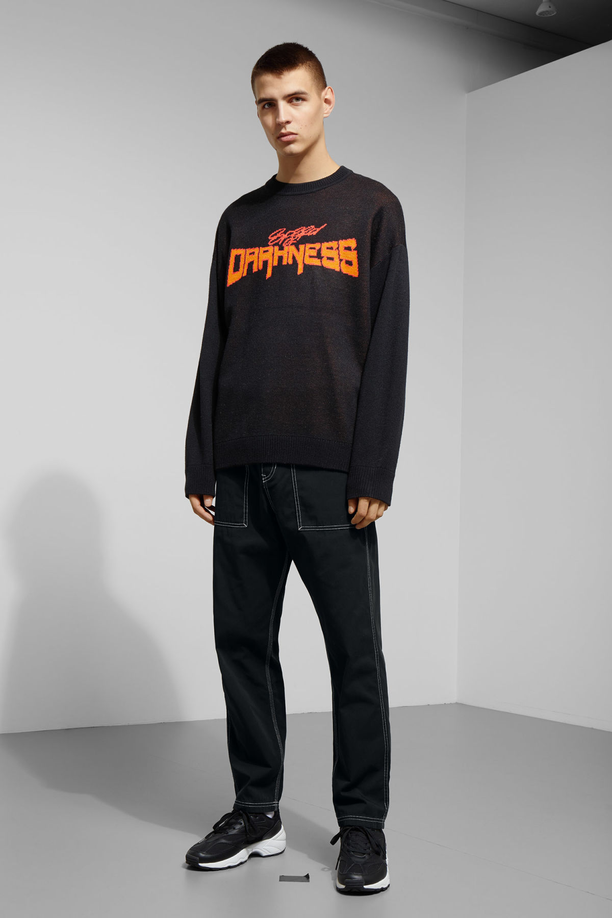 Model side image of Weekday diego jaquard sweater in black