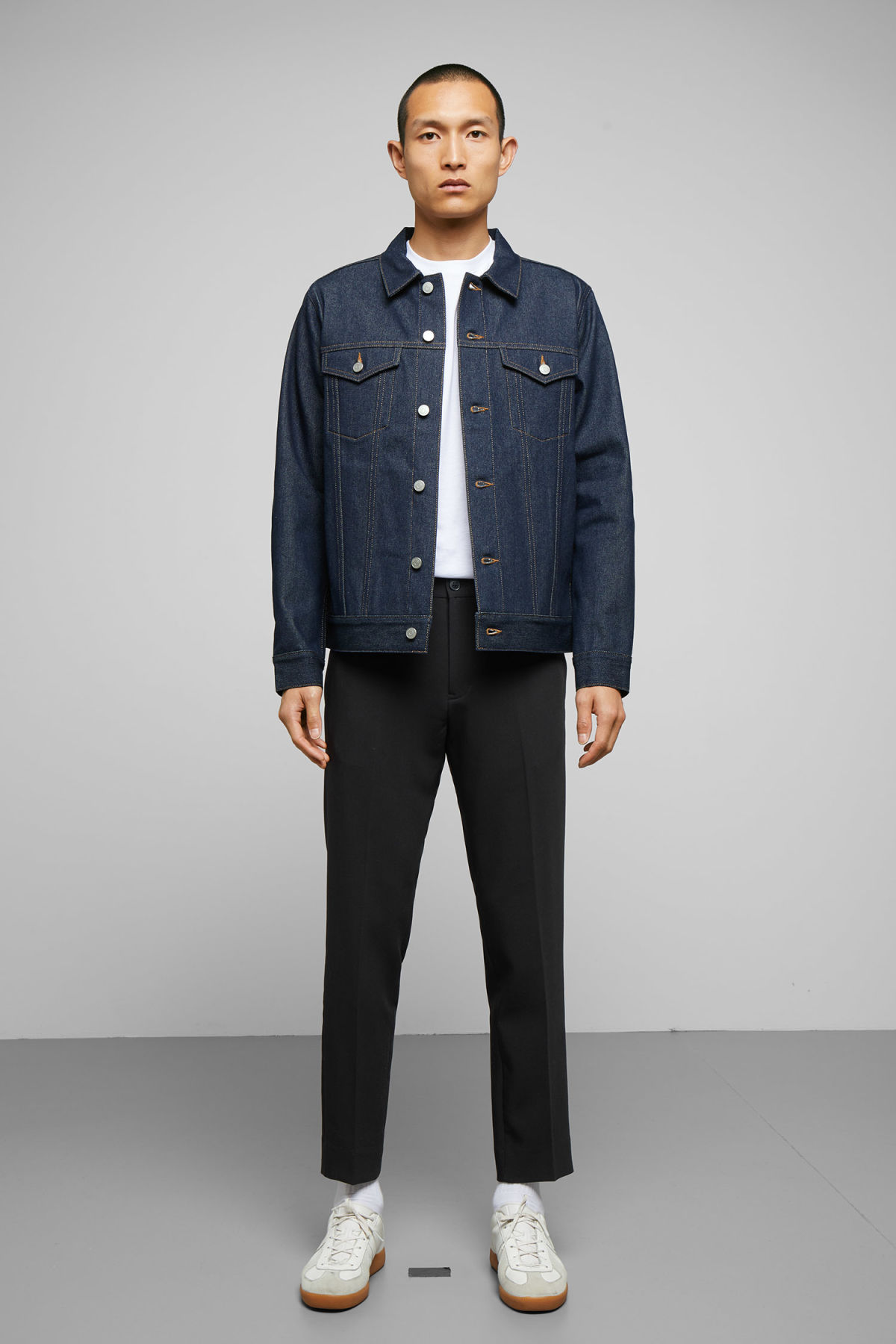 Model side image of Weekday single unwashed jacket in blue
